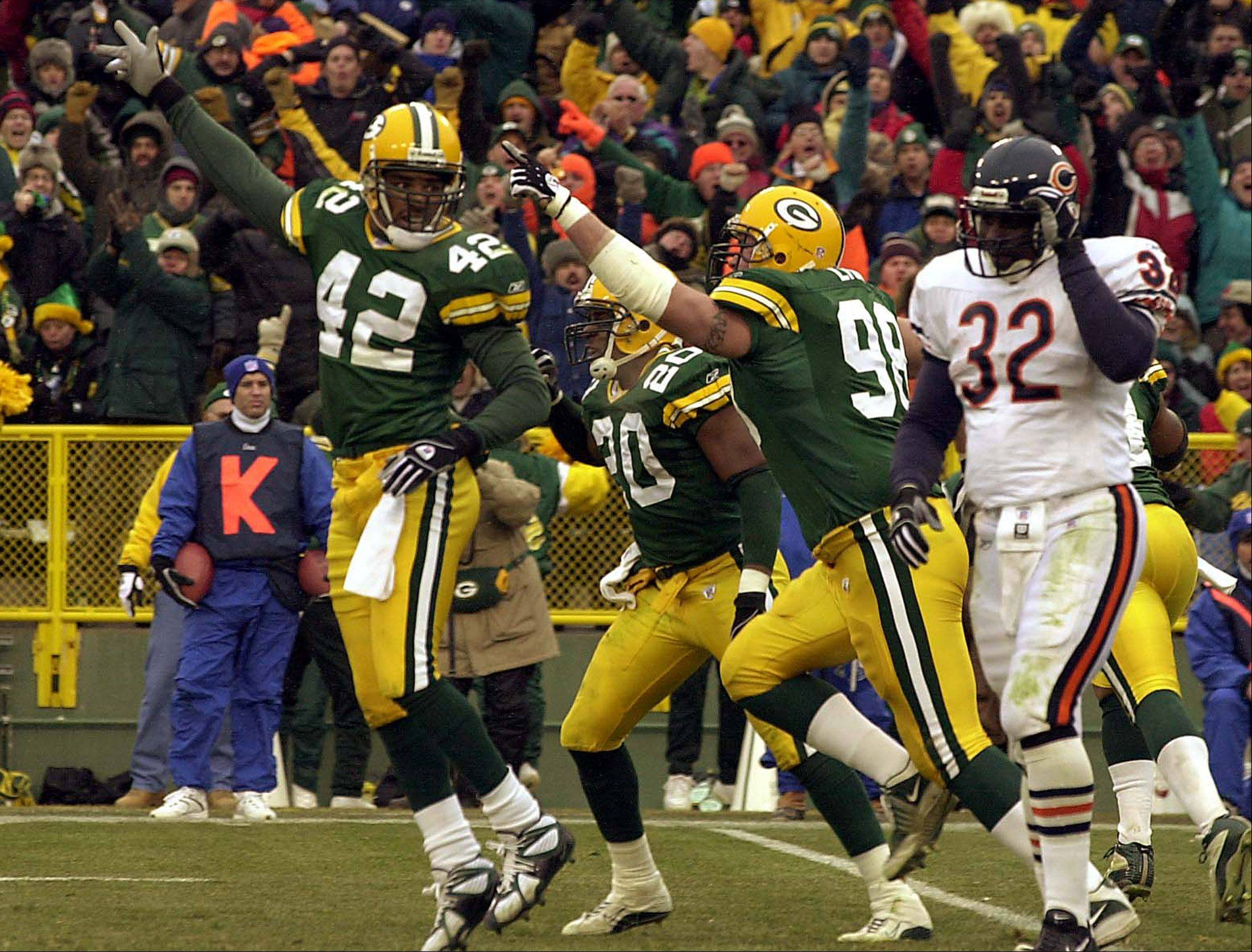 Darren Sharper, 42, celebrates as Leon Johnson walks away from a fumble as the Bears were close to scoring in this 2002 game.