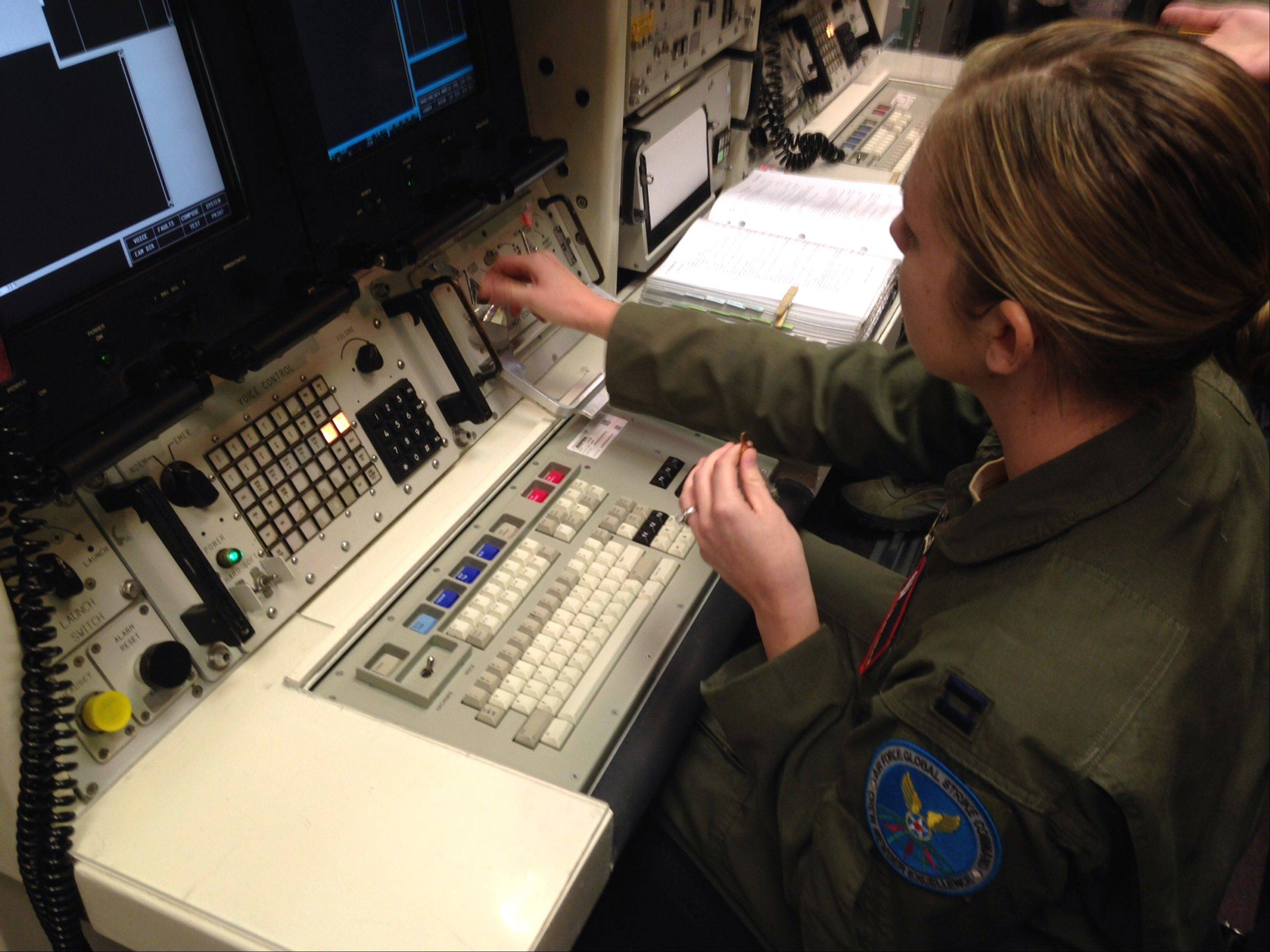Capt. Lauren Choate, a Minuteman 3 missile launch officer, at the console of a launch simulator used for training at F. E. Warren Air Force Base, Wyo.