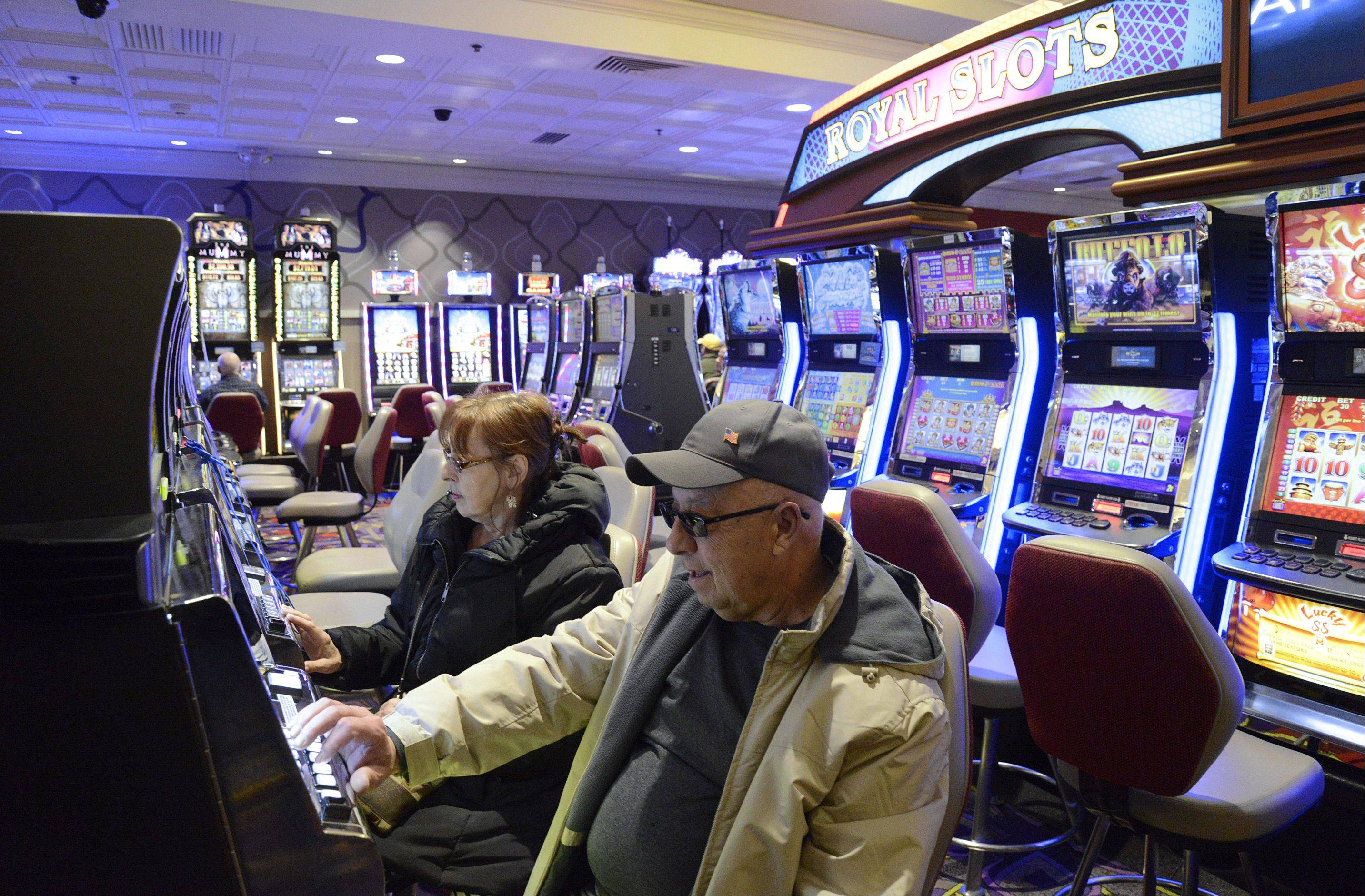 Carol and Mike Laskowski of Streamwood try their luck at the slots Friday at the Grand Victoria Casino in Elgin.