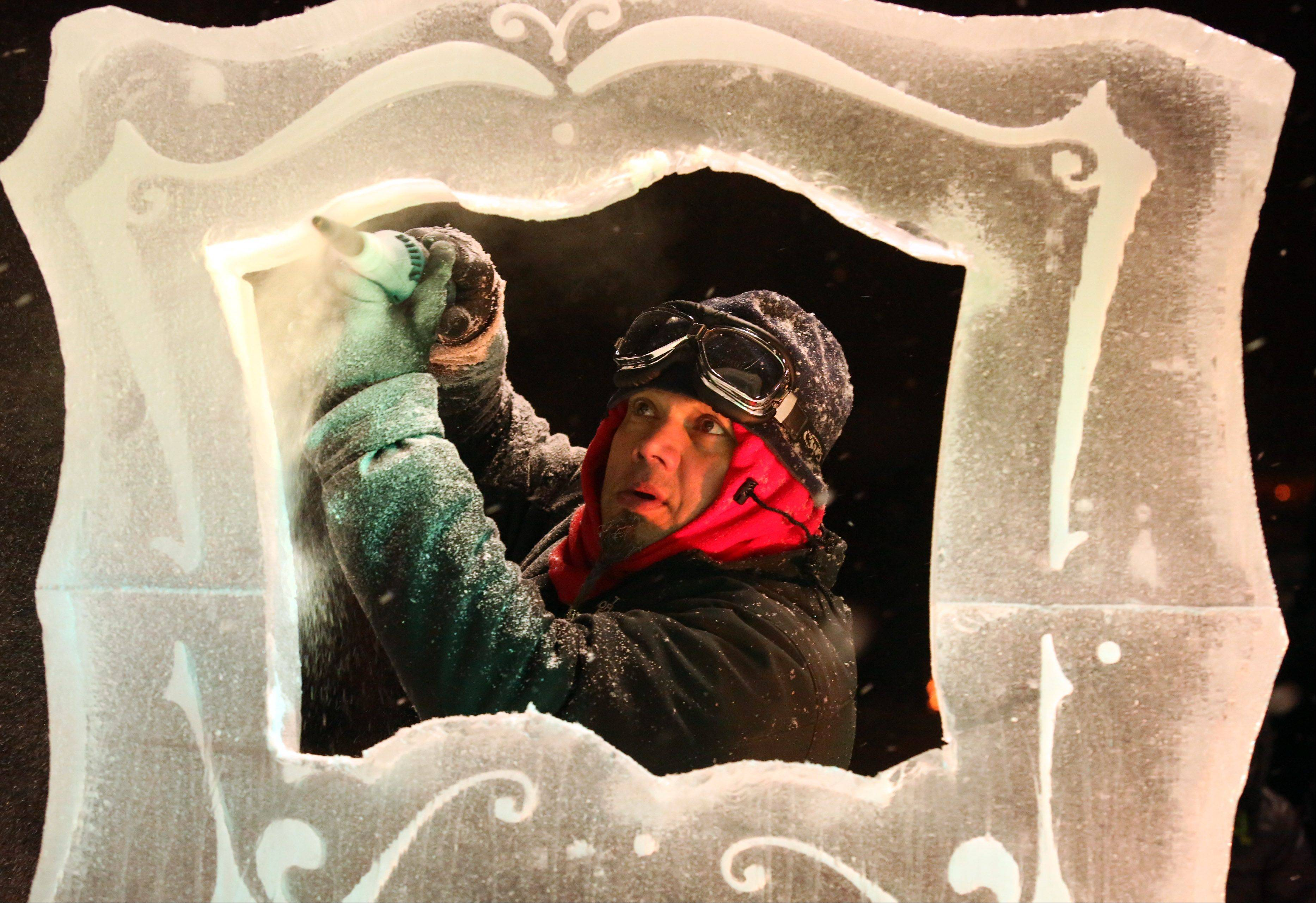 Master ice sculptor Max Bollkman Zuleta, owner of Art Below Zero, creates a frame on Friday night at the Gurnee Park District't annual Frosty Fest.