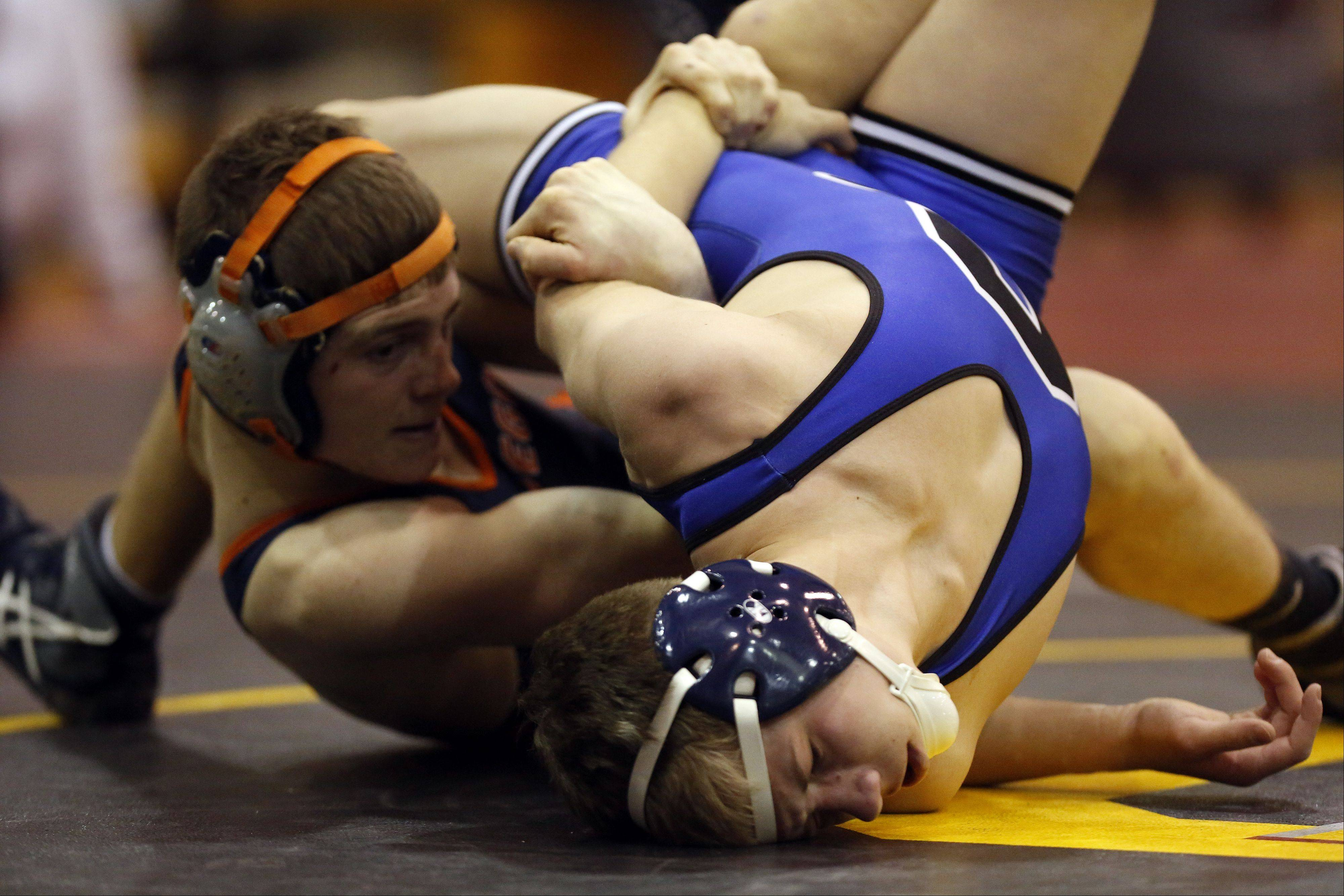 Oswego's Jack Pradel, left, wrestles Burlington Central's Adam Mengal at the 126 pound weight class Saturday, January 18, 2014 at the Batavia wrestling invite.