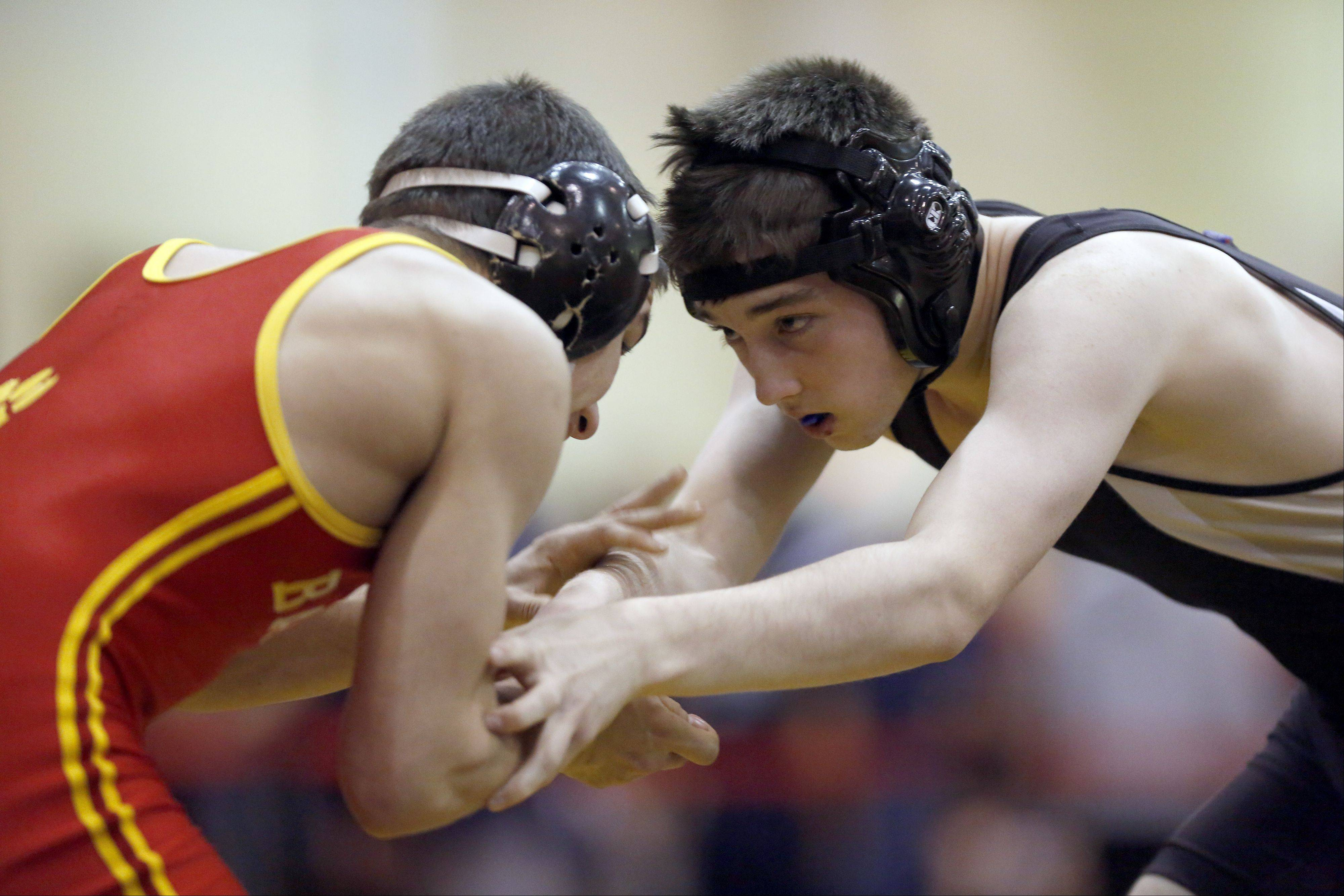 Batavia's Trevor Kilgalien, left, wrestles Streamwood's Ethan Brown in the 145 pound weight class Saturday, January 18, 2014 at the Batavia wrestling invite.