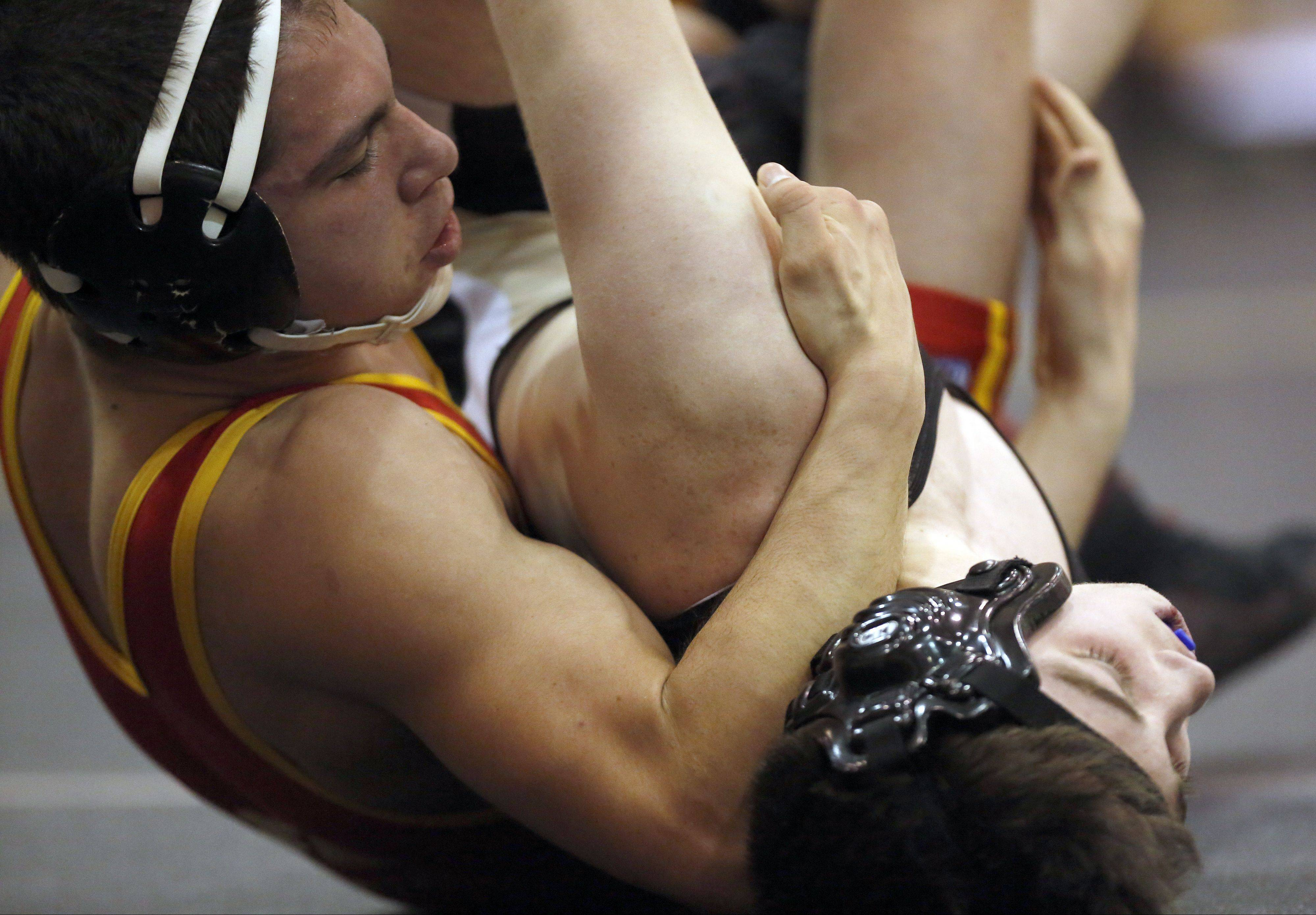 Batavia's Trevor Kilgalien, left, wrestles Streamwood's Ethan Brown in the 145-pound weight class Saturday at the Batavia invite.