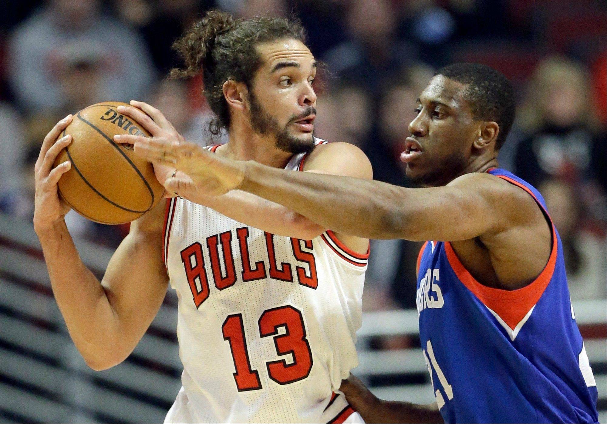 Associated PressChicago Bulls center Joakim Noah (13) looks to a pass as Philadelphia 76ers forward Thaddeus Young, right, guards during Saturday night's game at the United Center.