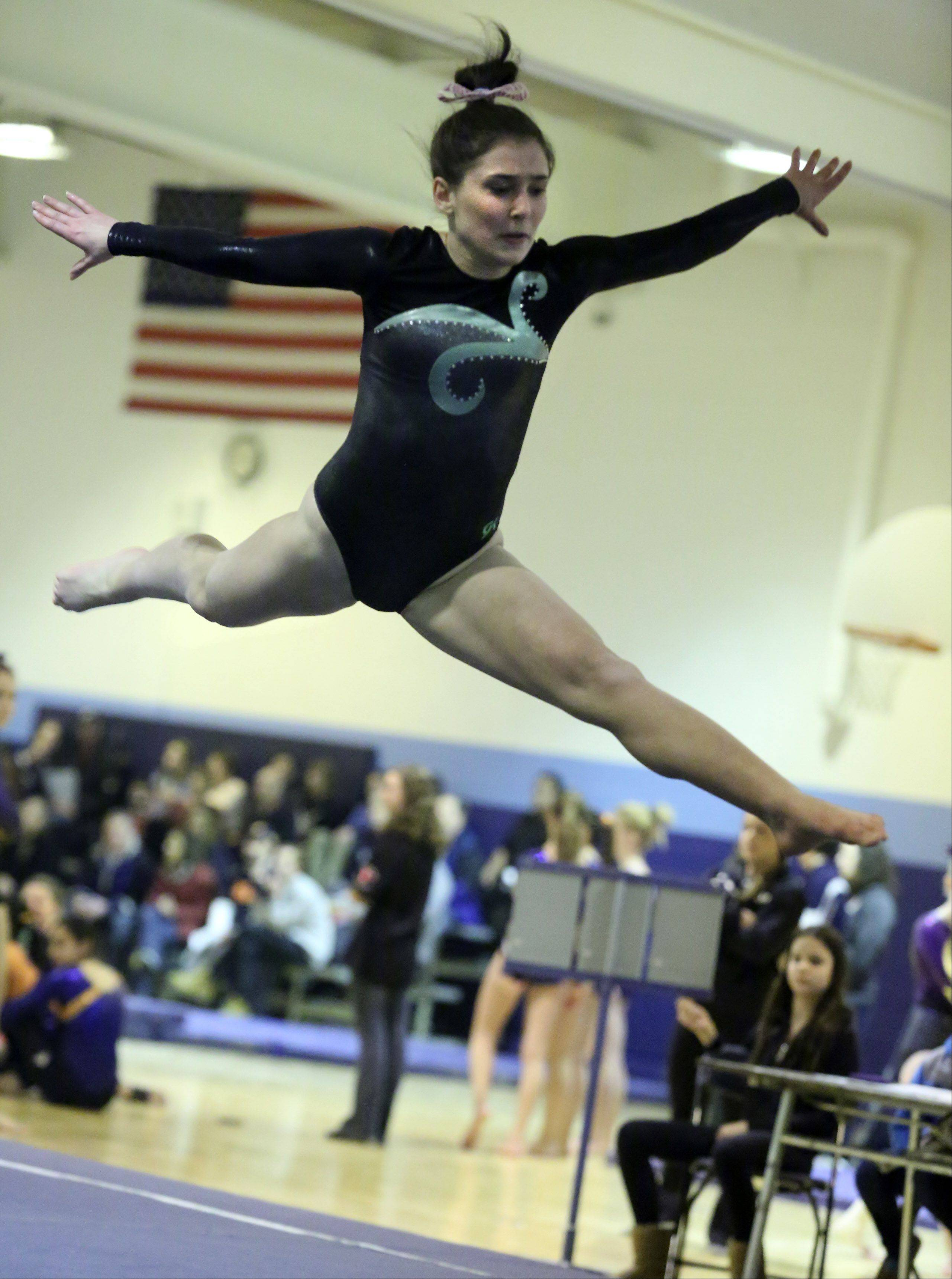 Elk Grove's Amelia Rafferty competes on floor exercise Saturday at Prospect.