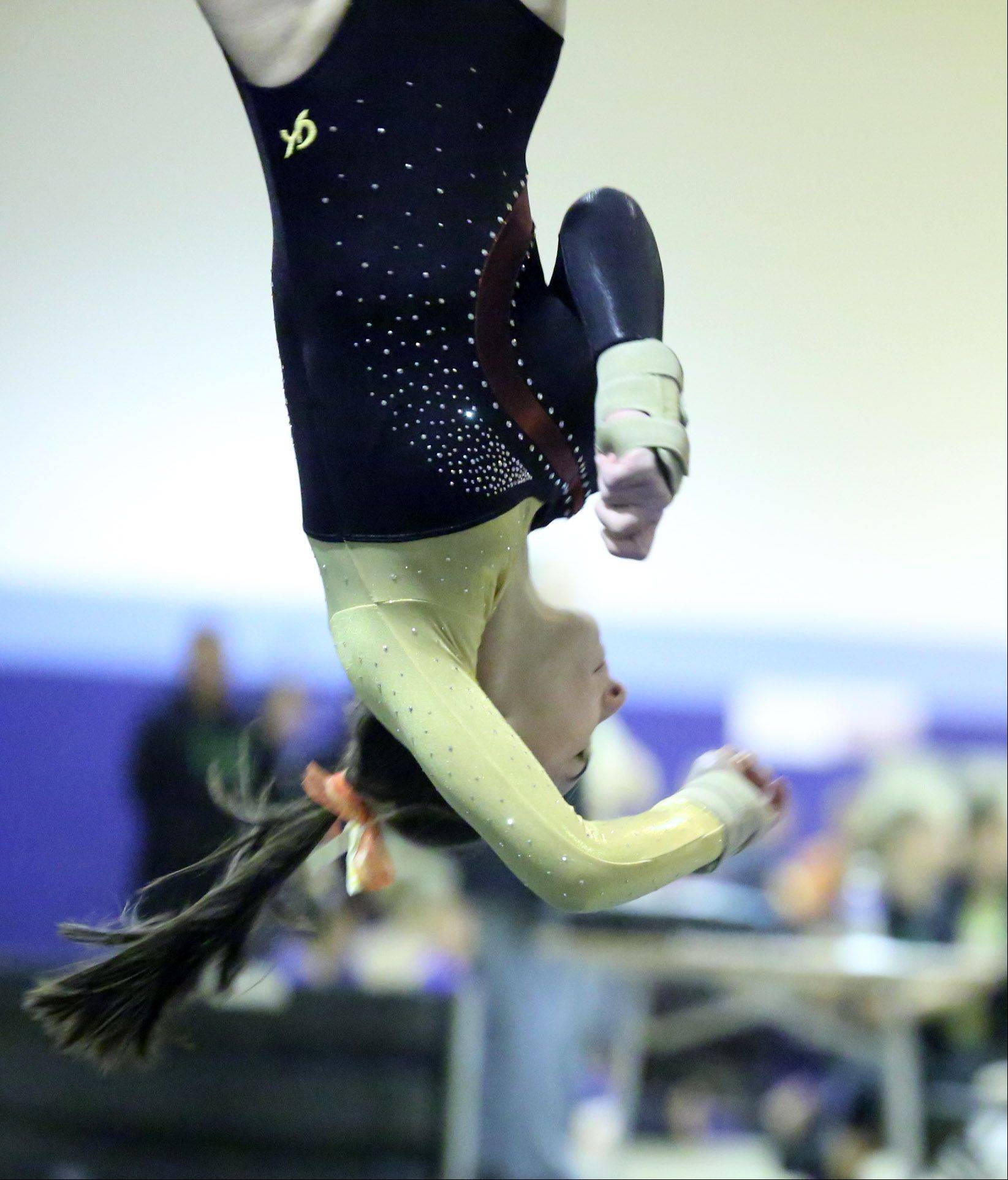 Schaumburg's Samantha Panther completes on floor exercise Saturday at Prospect.