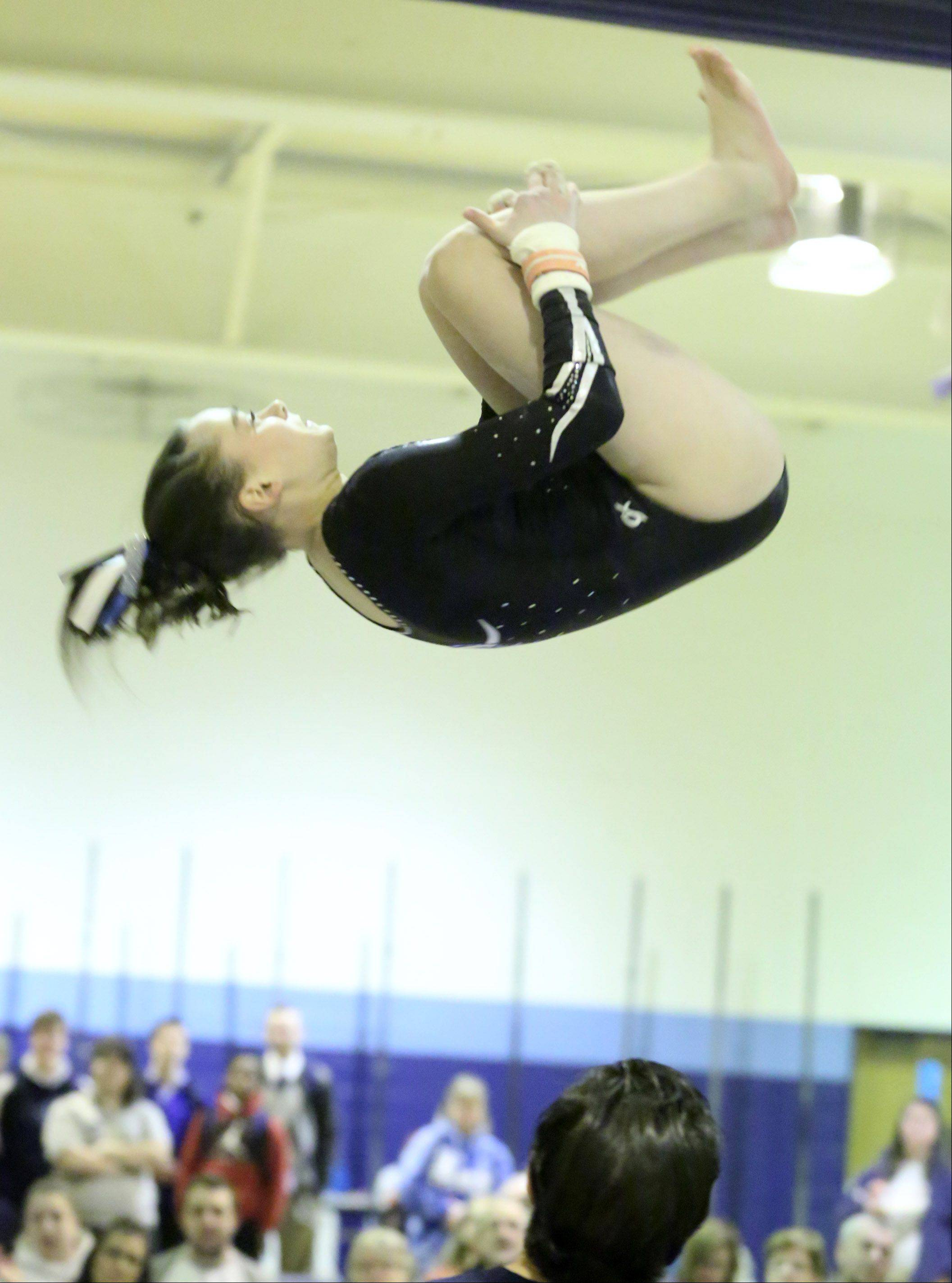 Prospect's Megan Donner dismounts from the uneven bars at Prospect on Saturday.