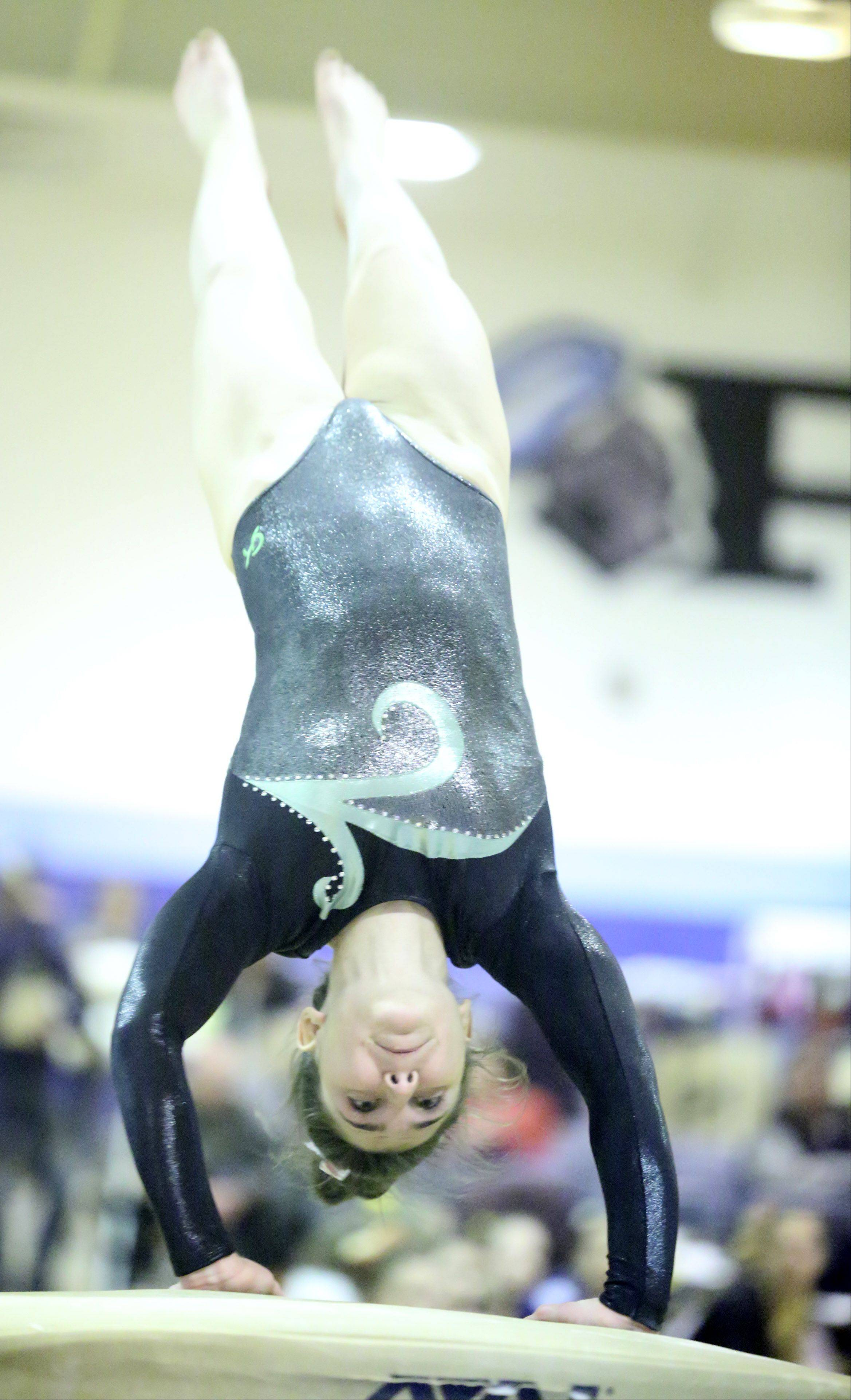 Elk Grove's Amelia Rafferty competes on vault at Prospect on Saturday.