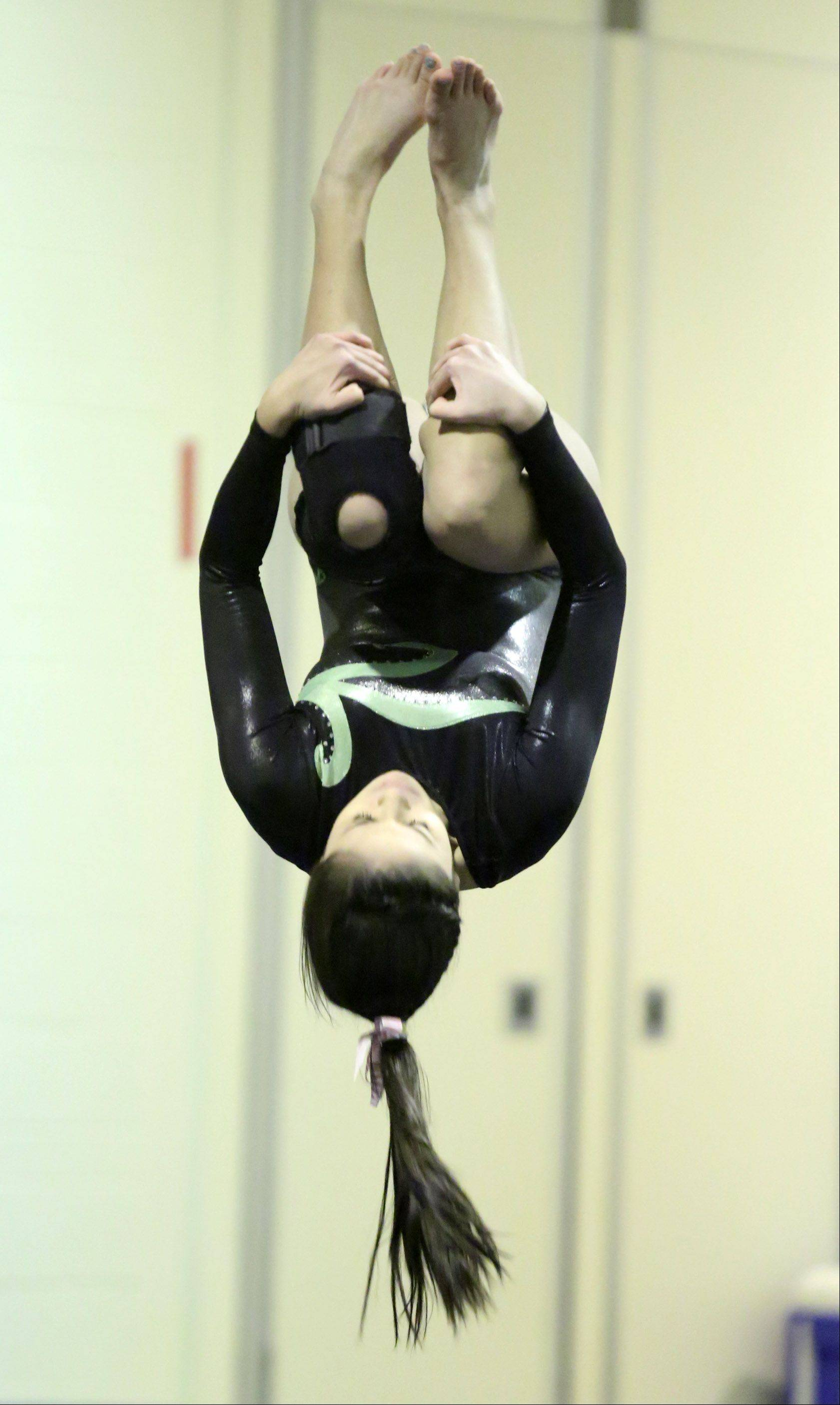 Elk Grove's Mia Loxiey competes on floor exercise at Prospect on Saturday.