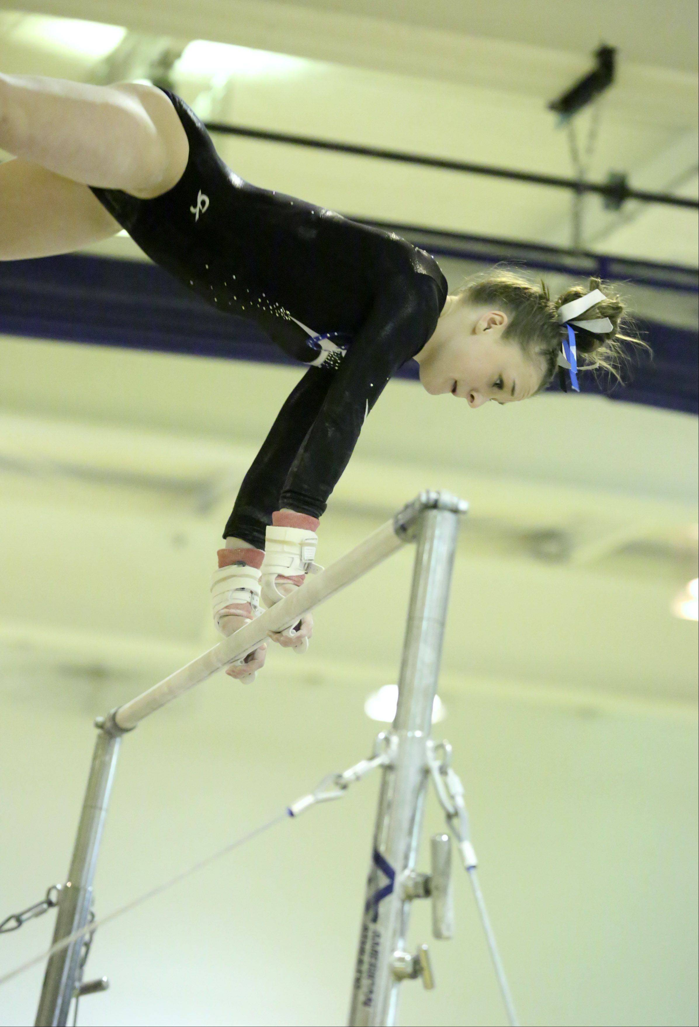 Prospect's Maddie Larock competes on the uneven bars at Prospect on Saturday.