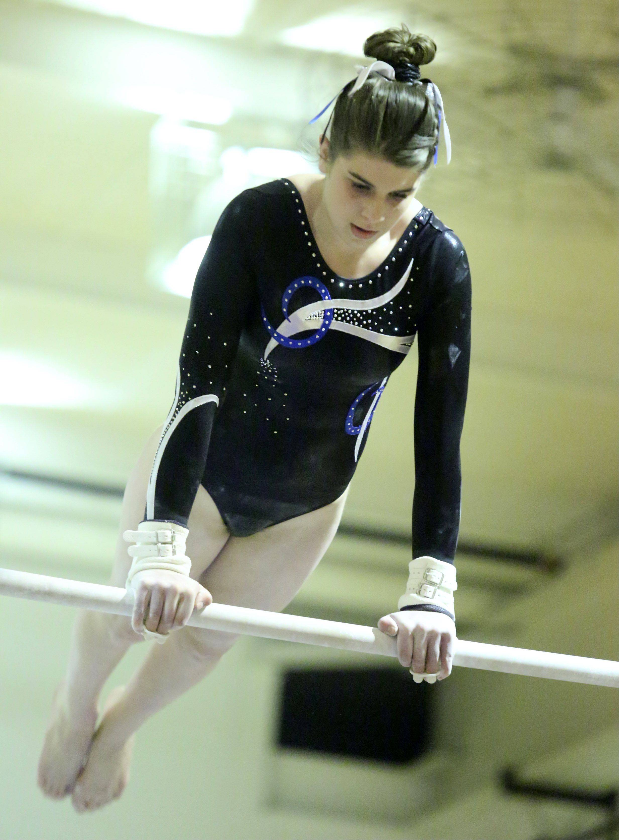 Prospect's Meghan Schmit competes on uneven bars at Prospect on Saturday.
