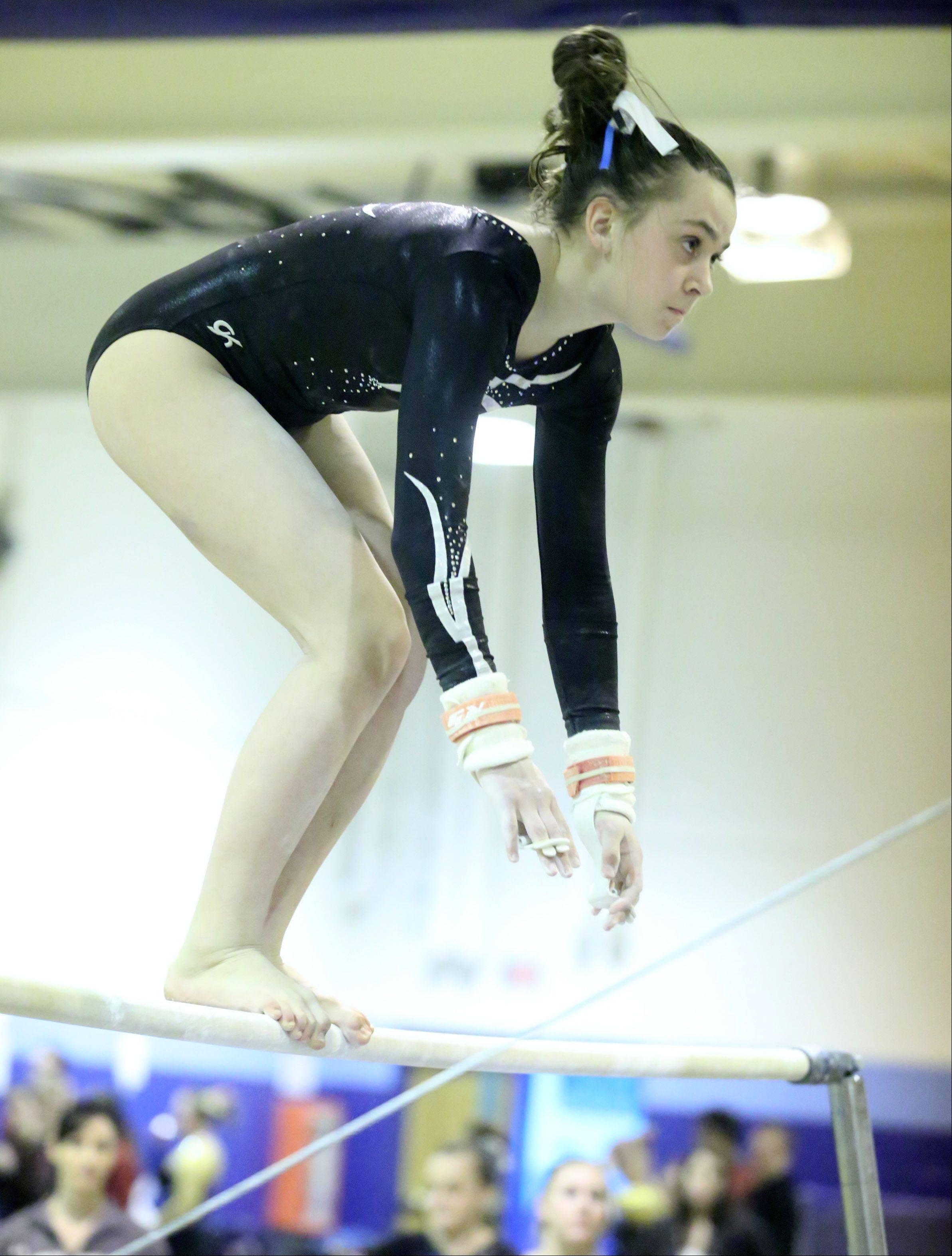 Prospect's Megan Donner competes on the uneven bars at a girls gymnastics invitational at Prospect on Saturday.