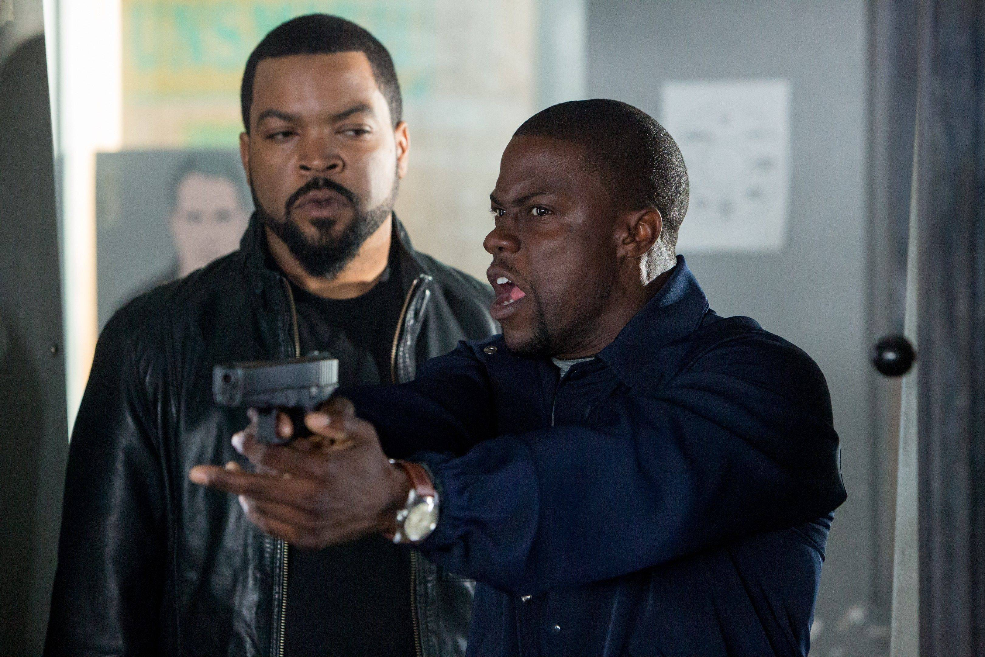 "This image released by Universal Pictures shows Ice Cube, left, and Kevin Hart in a scene from ""Ride Along."" ""Ride Along"" rolled into the top spot at the weekend box office beating out ""Jack Ryan: Shadow Recruit"" and ""Devil's Due."""