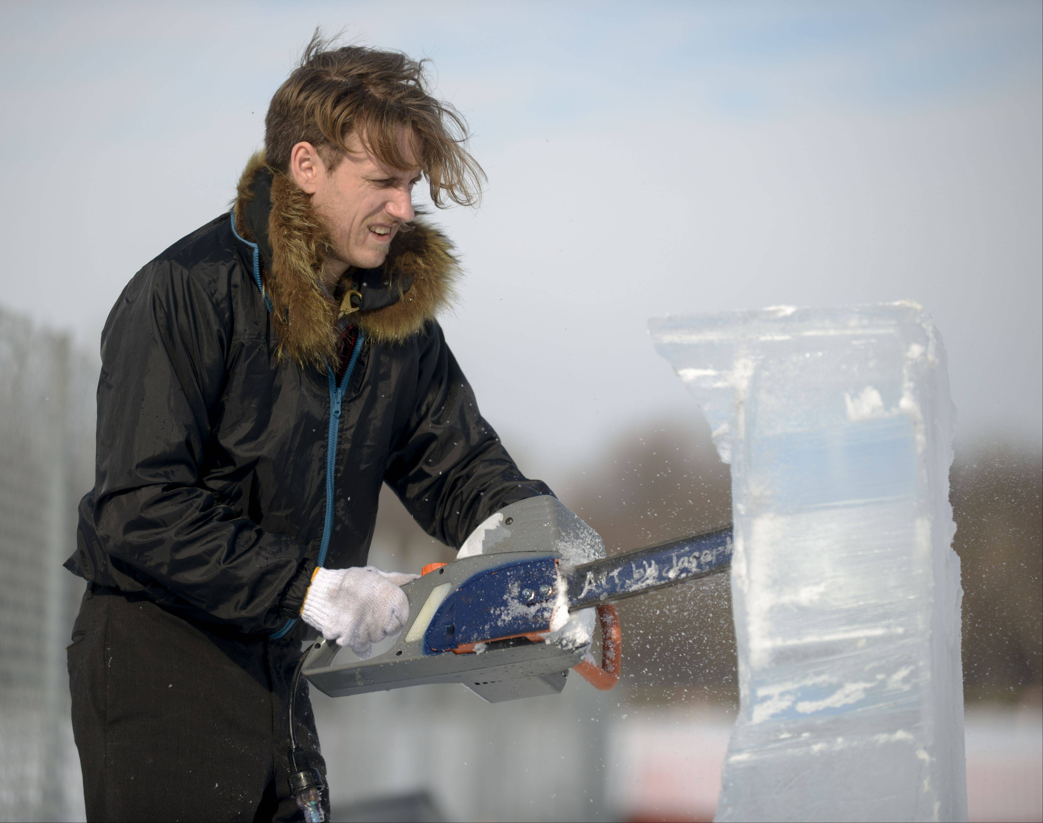 Ice carver Joseph Gagnepain of St. Charles works on a reindeer Sunday during Addison�s annual WinterFEST at Community Park. The event featured winter-themed events like snow golf and marshmallow roasting, as well as indoor activities like an obstacle course and bounce house.