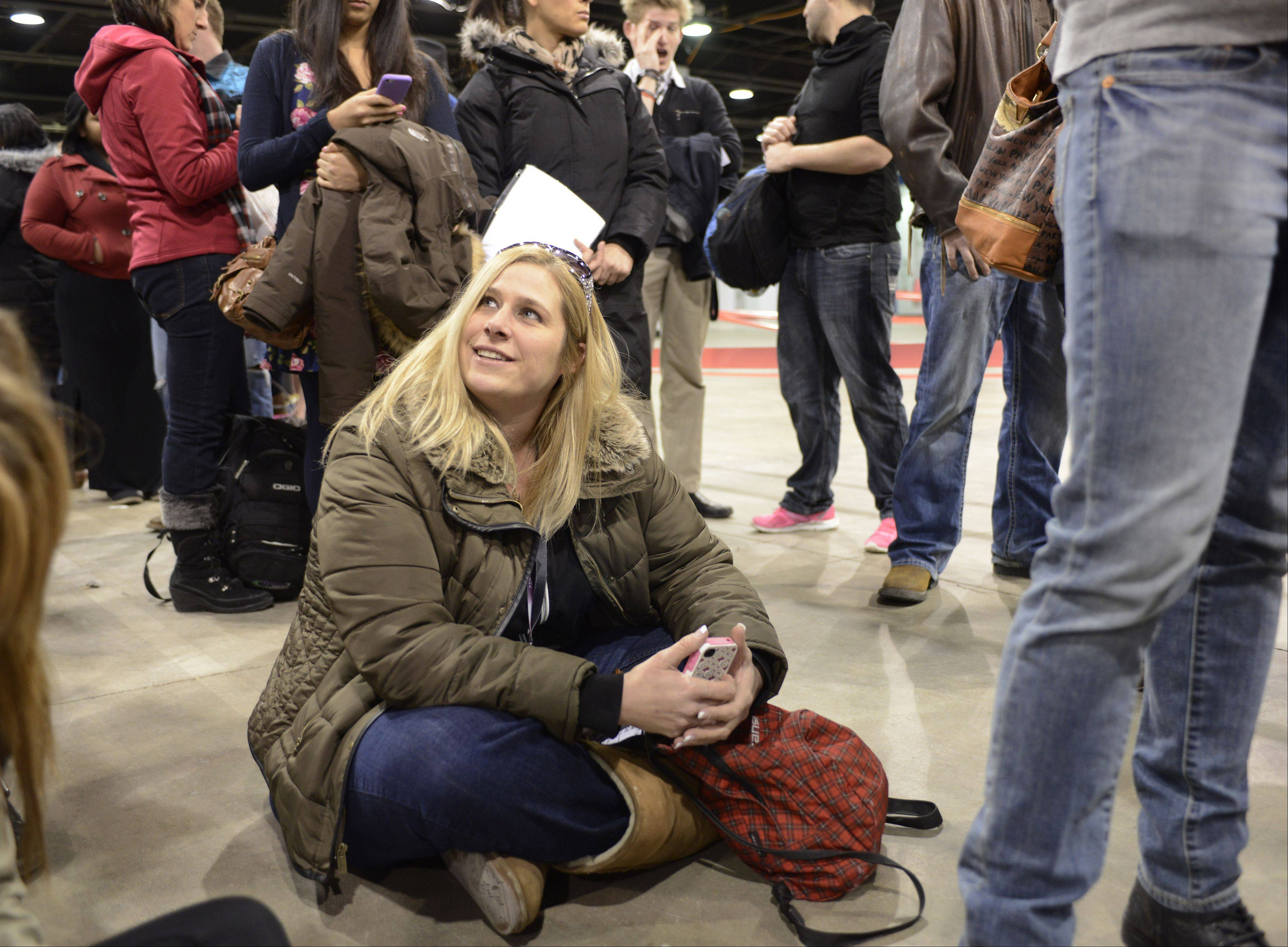 Kim Noe of Palatine waits in line to audition Sunday for the NBC television signing competition �The Voice� at the Stephens Convention Center in Rosemont. Hundreds of aspiring singers from across the suburbs traveled to Rosemont over the weekend to try out for the show.