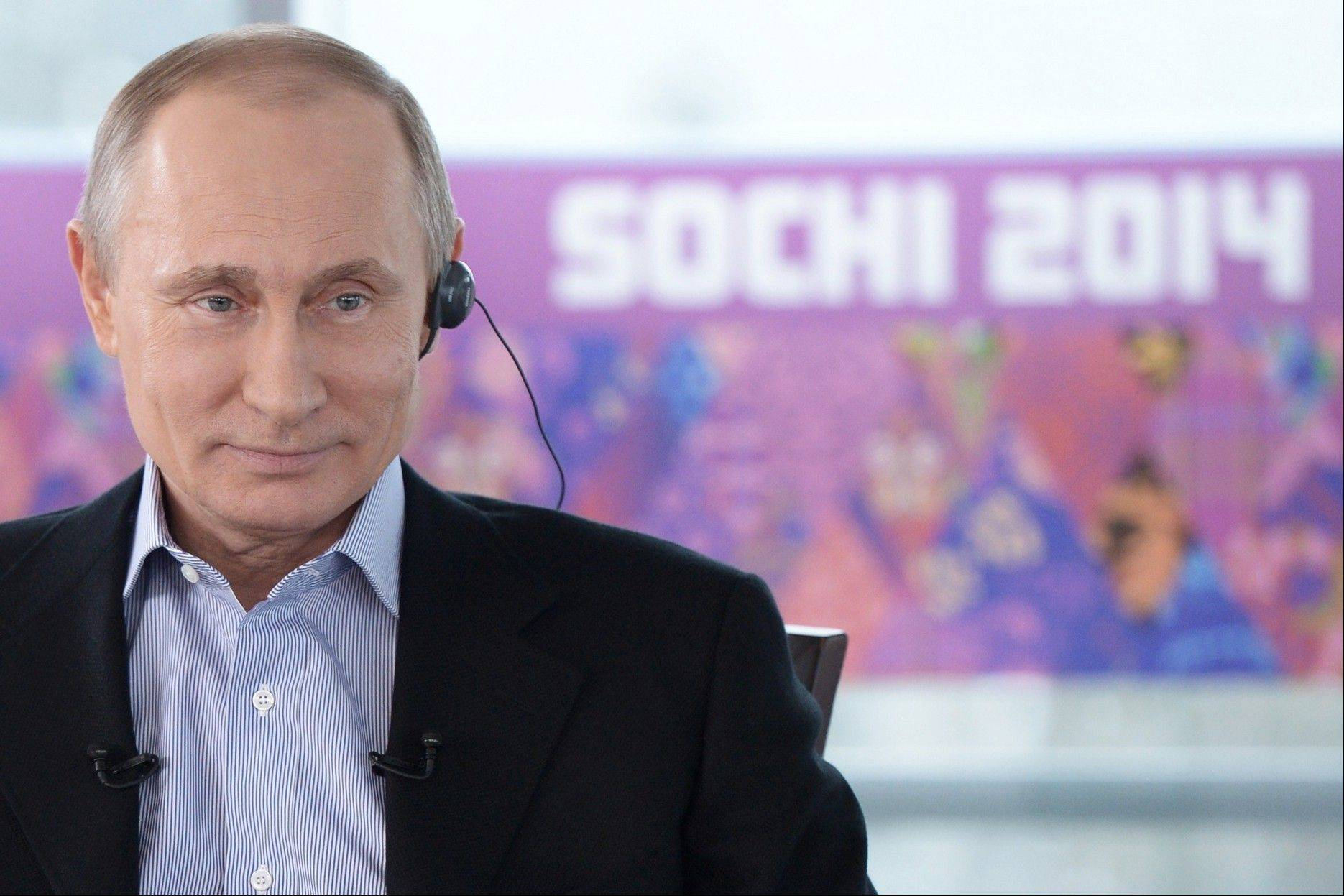 "Russian President Vladimir Putin listens to a translation during an interview to Russian and foreign media at the Russian Black Sea resort of Sochi, which will host Winter Olympic Games on Feb. 7, 2014. In the interview, Putin equated gays with pedophiles and spoke of the need for Russia to ""cleanse"" itself of homosexuality as part of efforts to increase the birth rate."