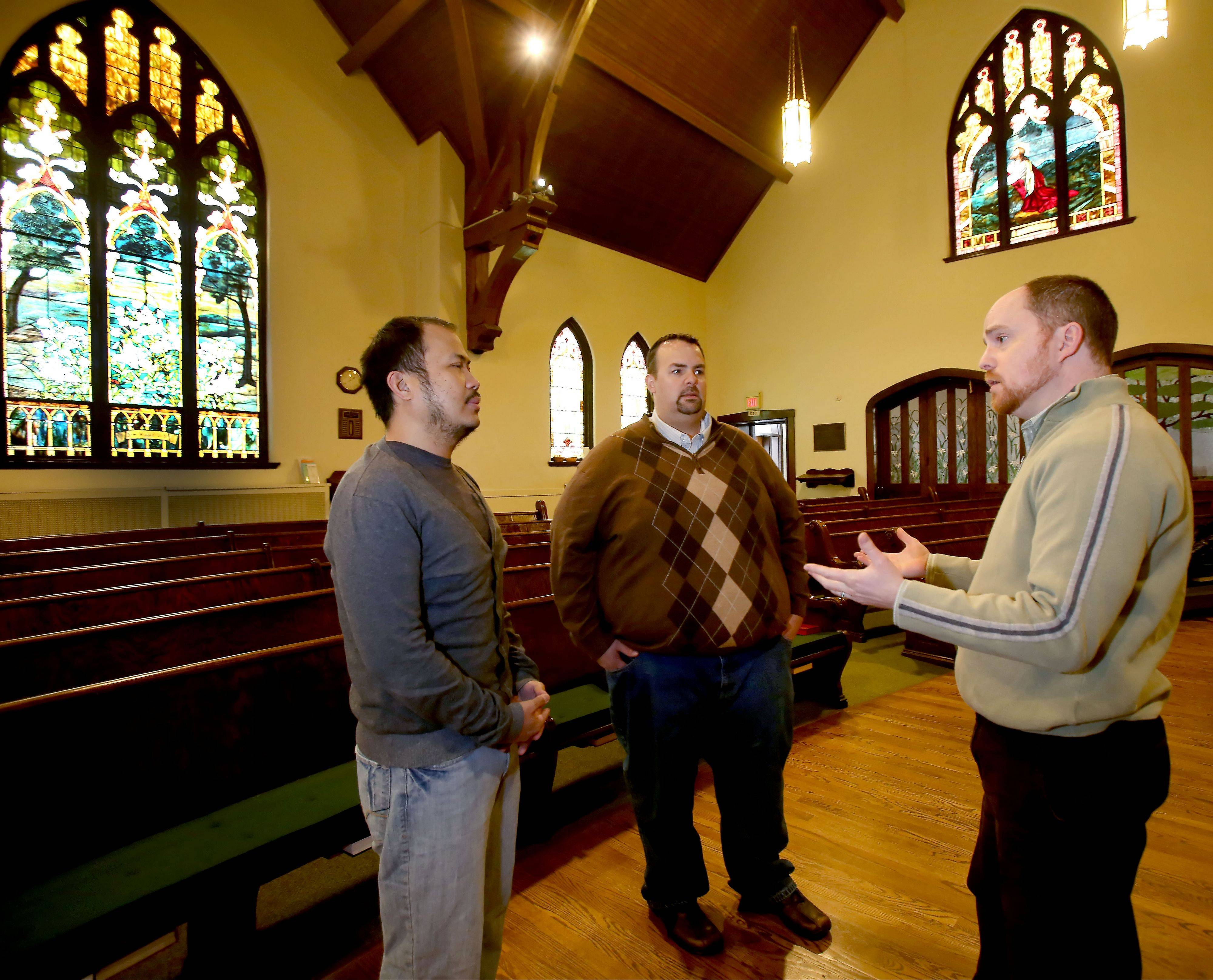 Jovi Tomaneng, left, and John Stilp, center, of Naperville discuss wedding plans with their pastor, the Rev. Mark Winters at First Congregational United Church of Christ in Naperville.