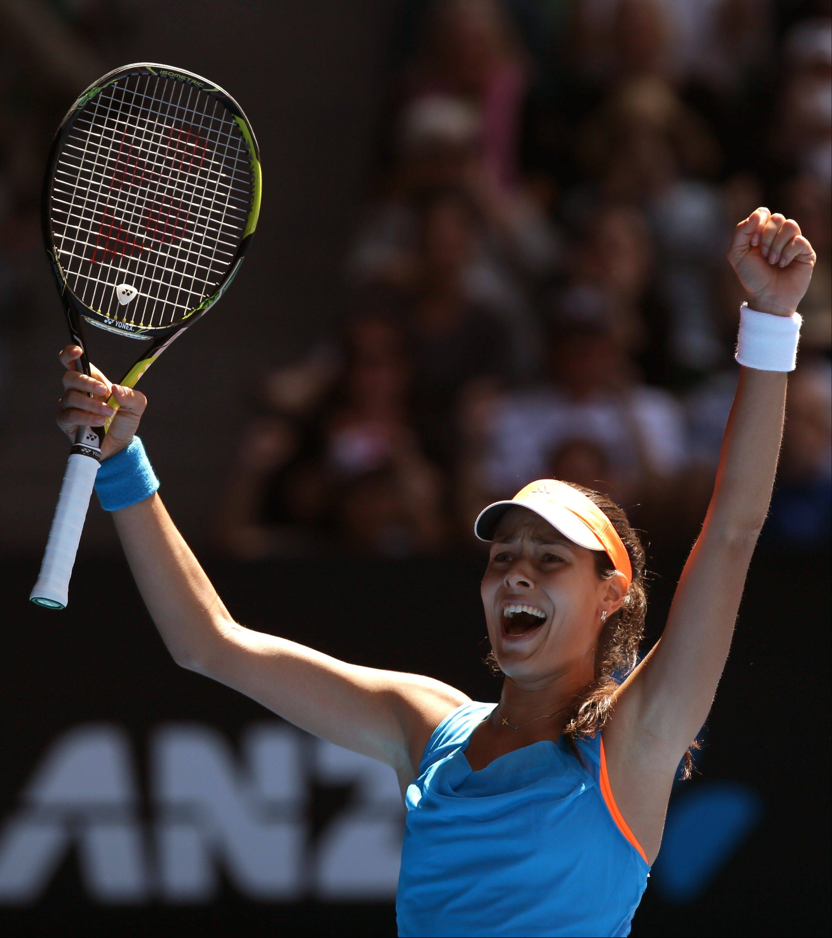 Ana Ivanovic of Serbia celebrates her win over Serena Williams of the U.S. during their fourth round match at the Australian Open tennis championship in Melbourne, Australia.