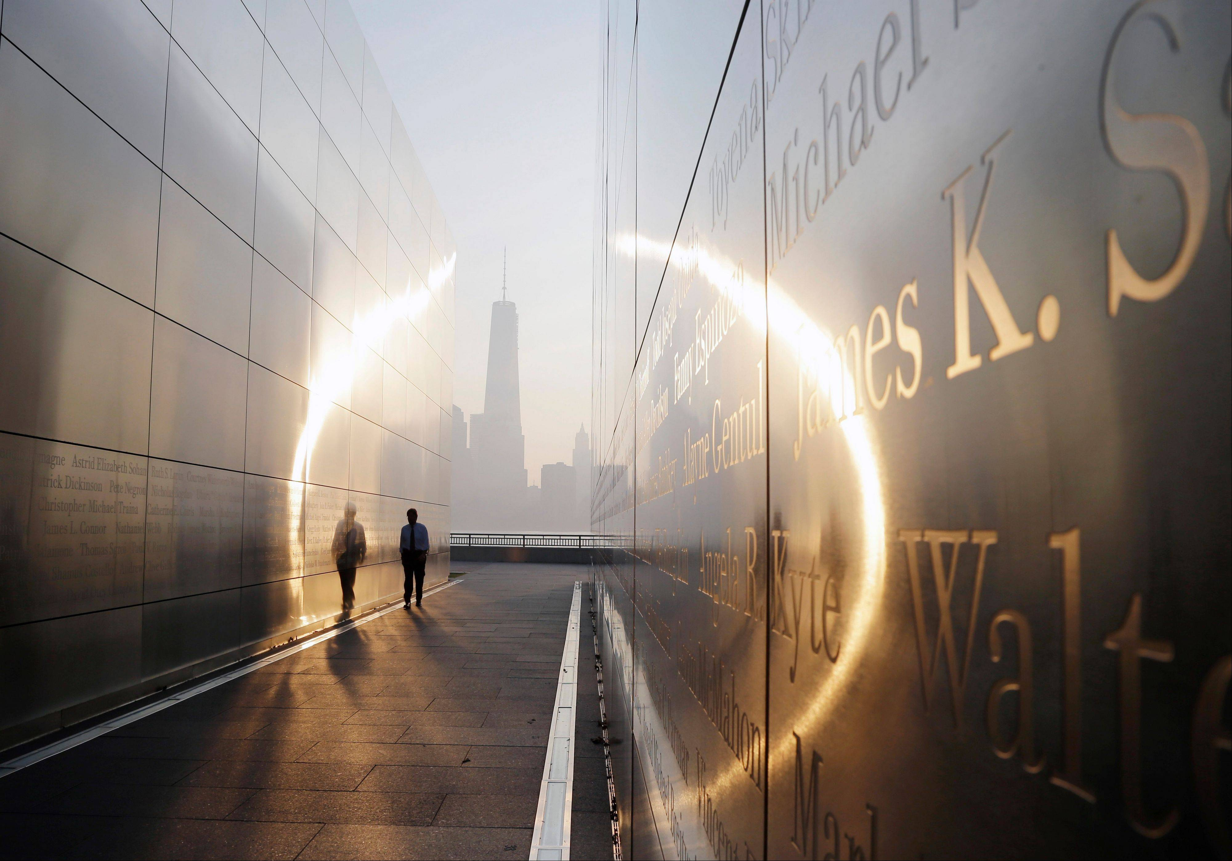 "A visitor walks through the ""Empty Sky"" memorial in Jersey City, N.J., that is dedicated to New Jersey's victims of the Sept. 11, 2001, terrorist attacks."