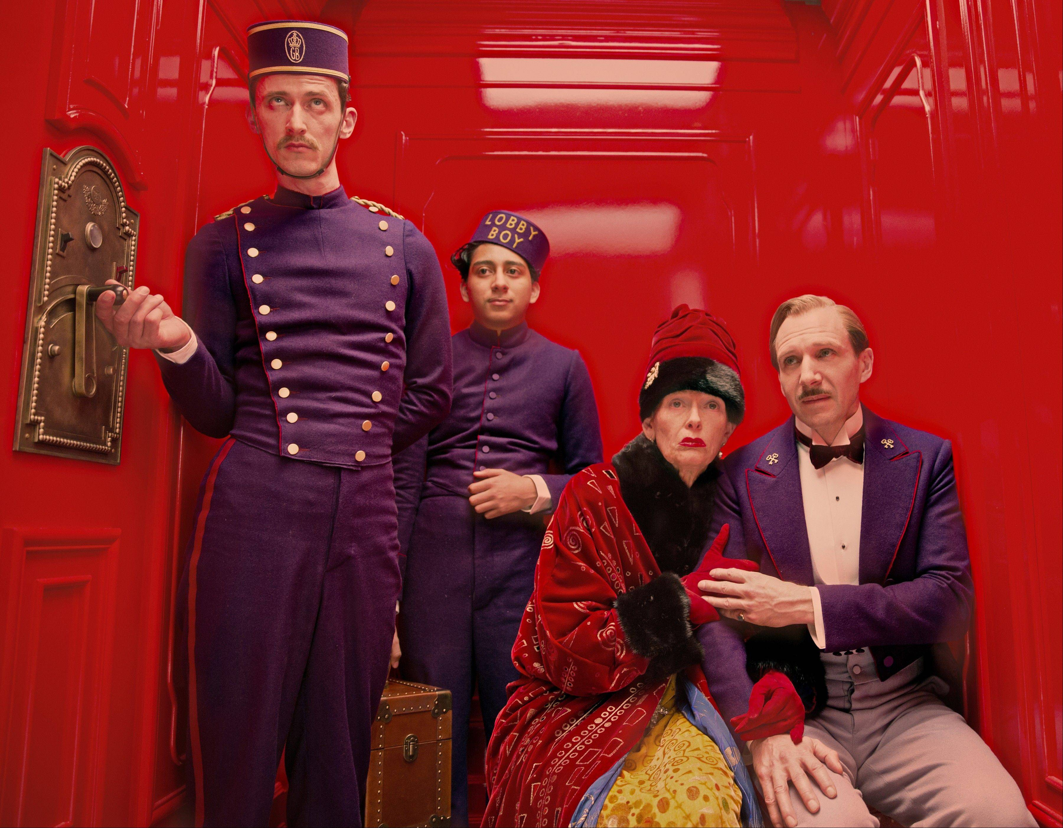 "Paul Schlase, left, Tony Revelori, Tilda Swinton and Ralph Fiennes star in ""The Grand Budapest Hotel"" from Wes Anderson."