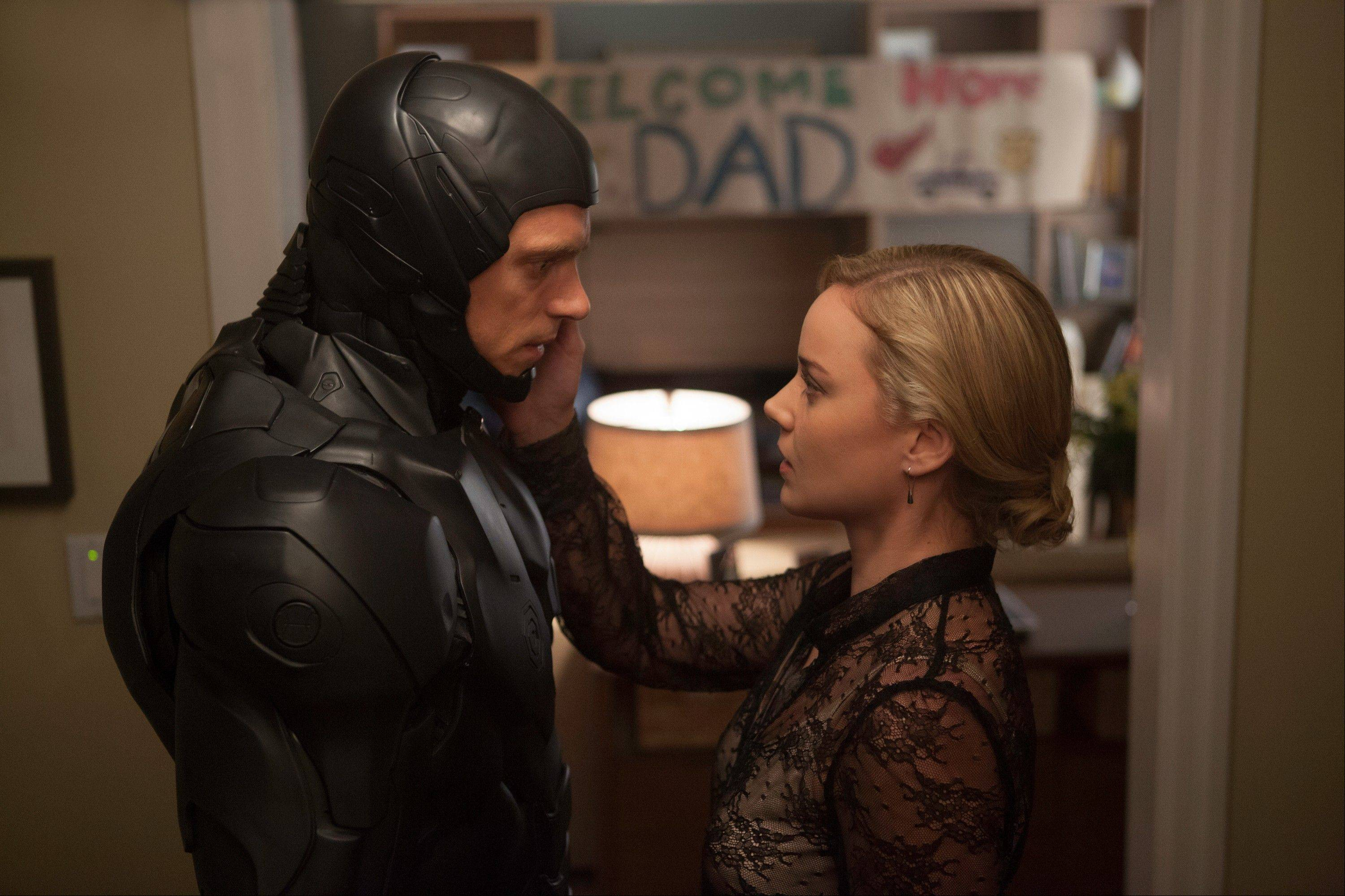 "Joel Kinnaman, left, and Abbie Cornish star in the remake ""Robocop."""