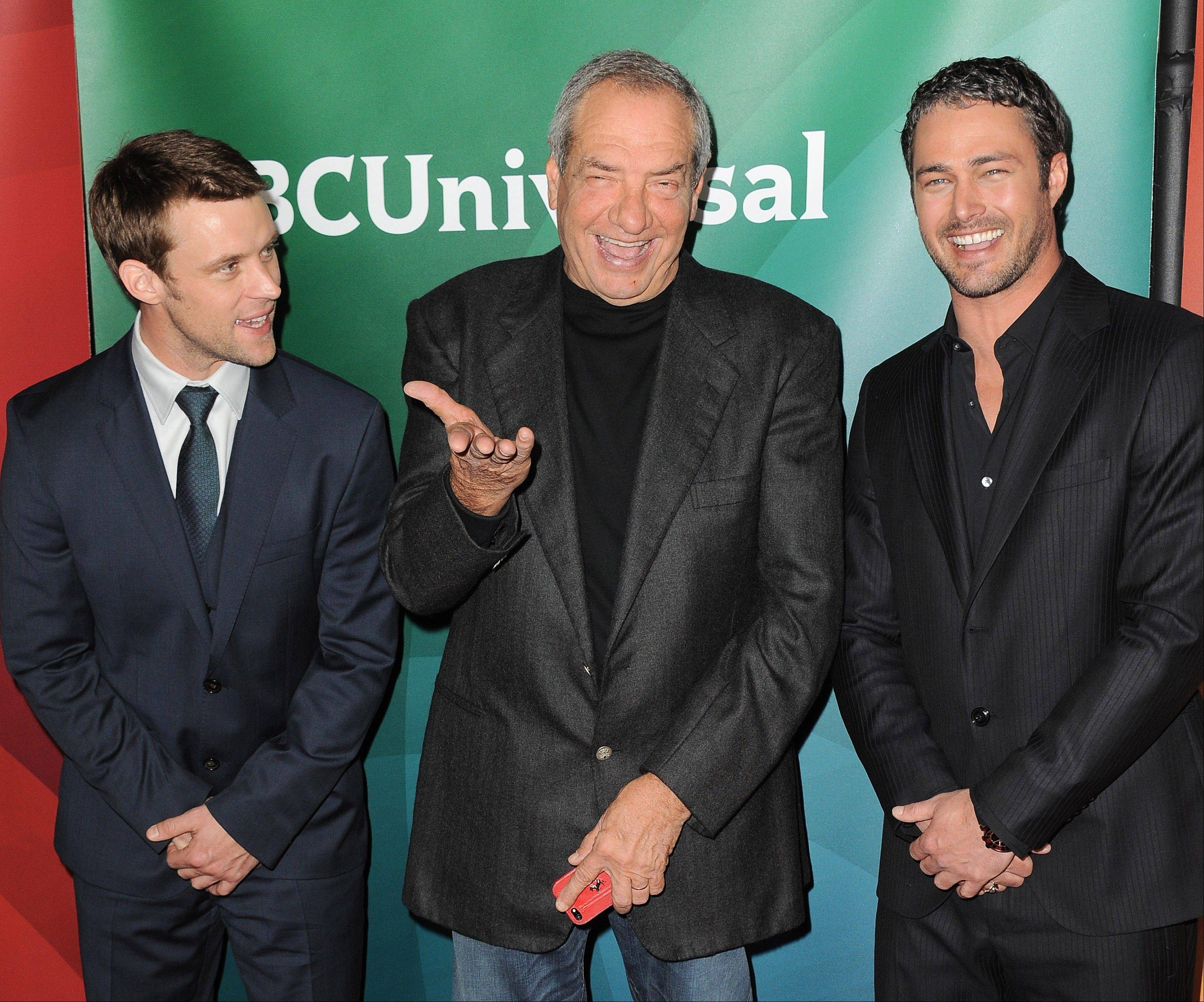 "Dick Wolf, center -- with Jesse Spencer, left, and Taylor Kinney of NBC's ""Chicago Fire"" -- hopes his ""Chicago"" series will spawn a third Chicago-set show."