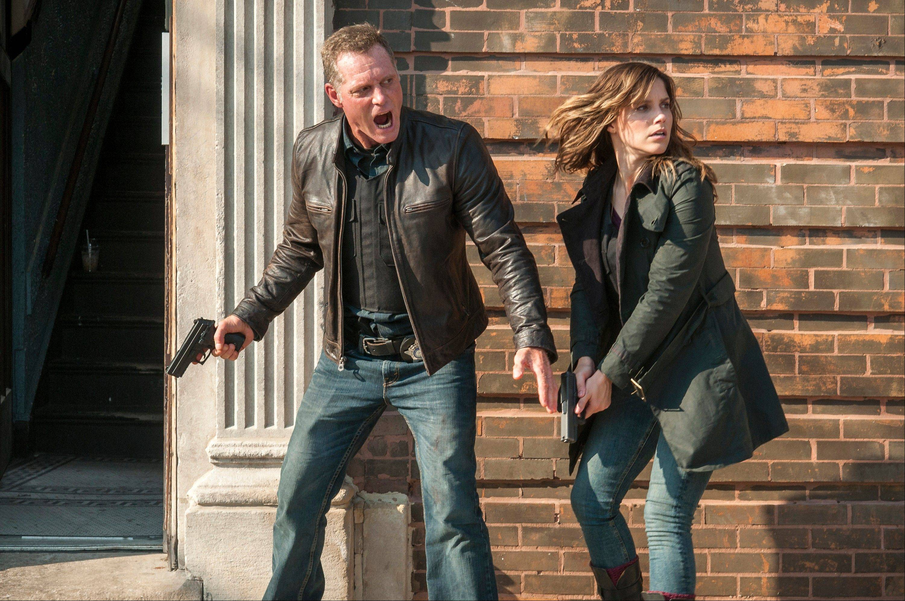 "Detective Sgt. Hank Voight (Jason Beghe), left, and Erin Lindsay (Sophia Bush) are pitted against the worst killers, drug traffickers and mobsters the Windy City can deliver in Dick Wolf's new series, ""Chicago P.D."""