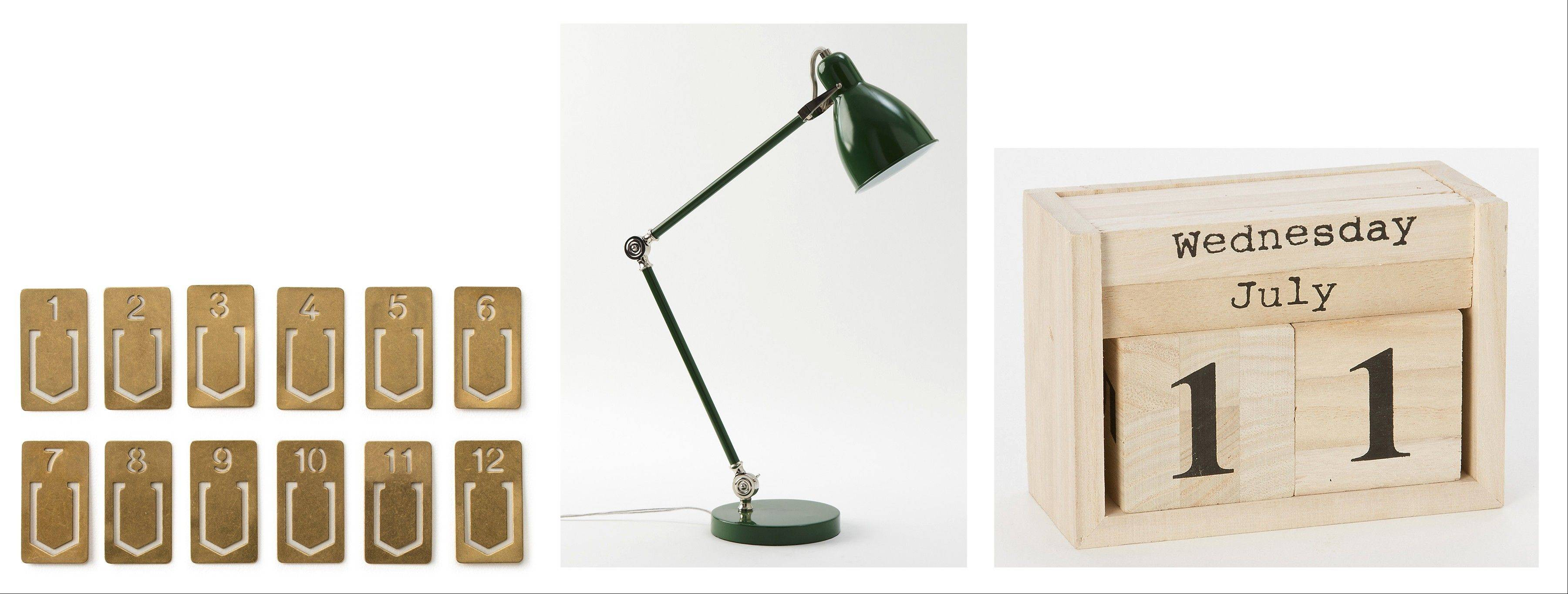 From left, brass-hued number clips can be used to label files and organize notes; Terrain's Woodlblock Calendar brings a bit of nature into the home office; West Elm's Industrial Task Table Lamp is a good choice for a desk light.