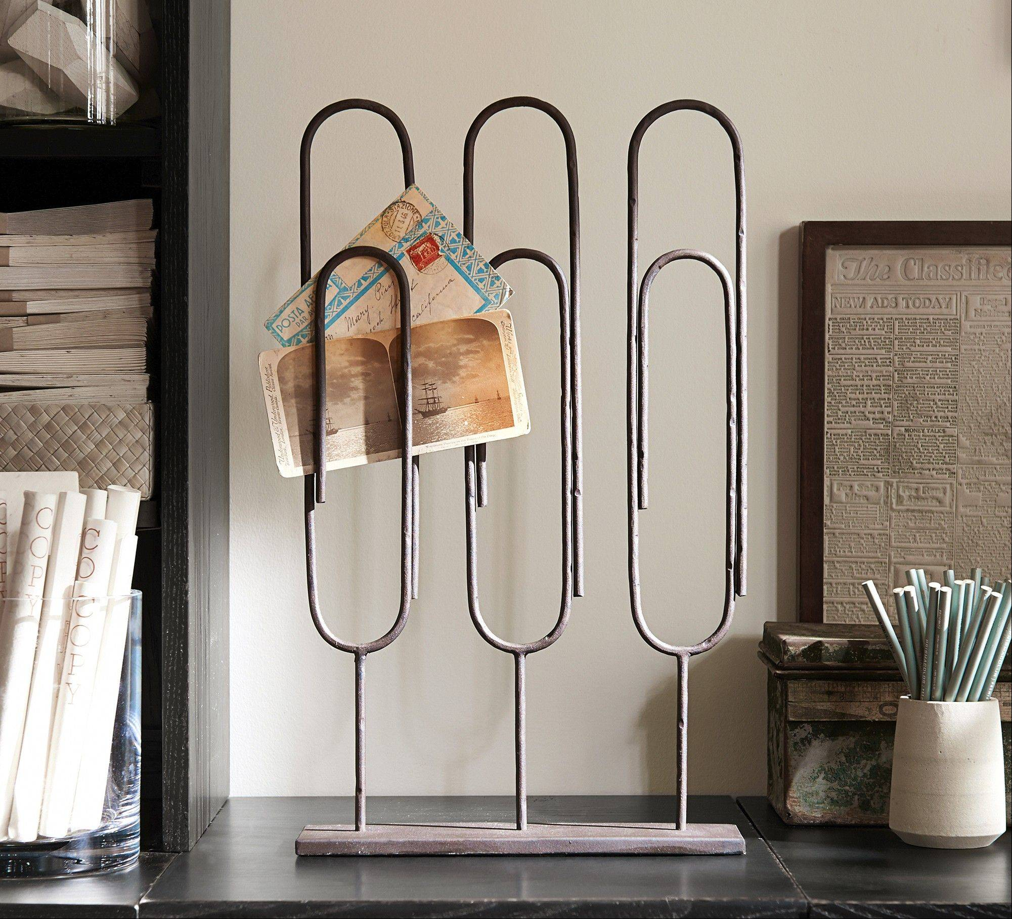 Display photos and keepsakes in the Standing Paper Clip, with has three large clips for organizing memorabilia.