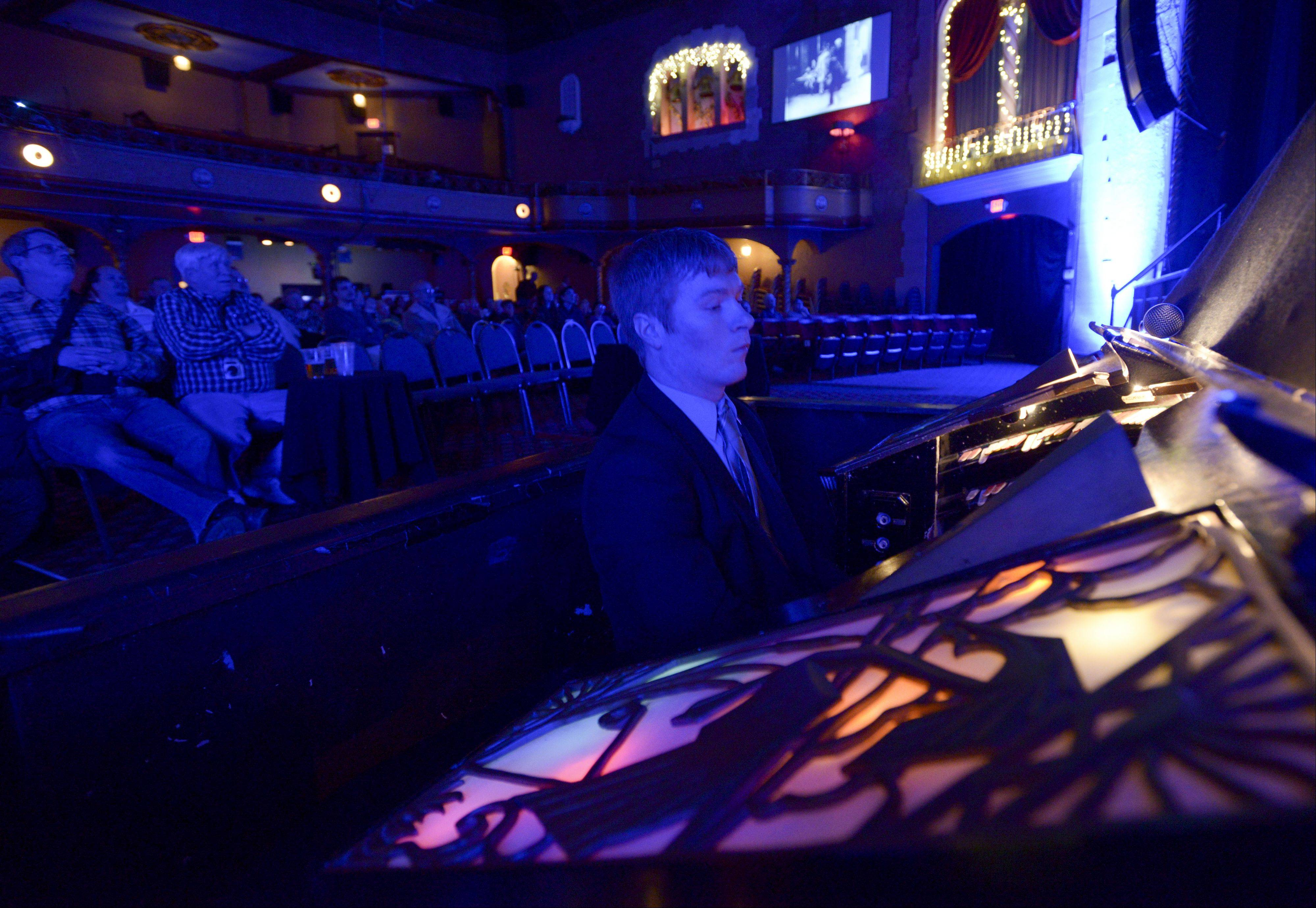 Organist Glenn Tallar plays the organ to a silent film during the Arcada Theatre's tribute to long time organist Jim Shaffer, who died in November at age 78.