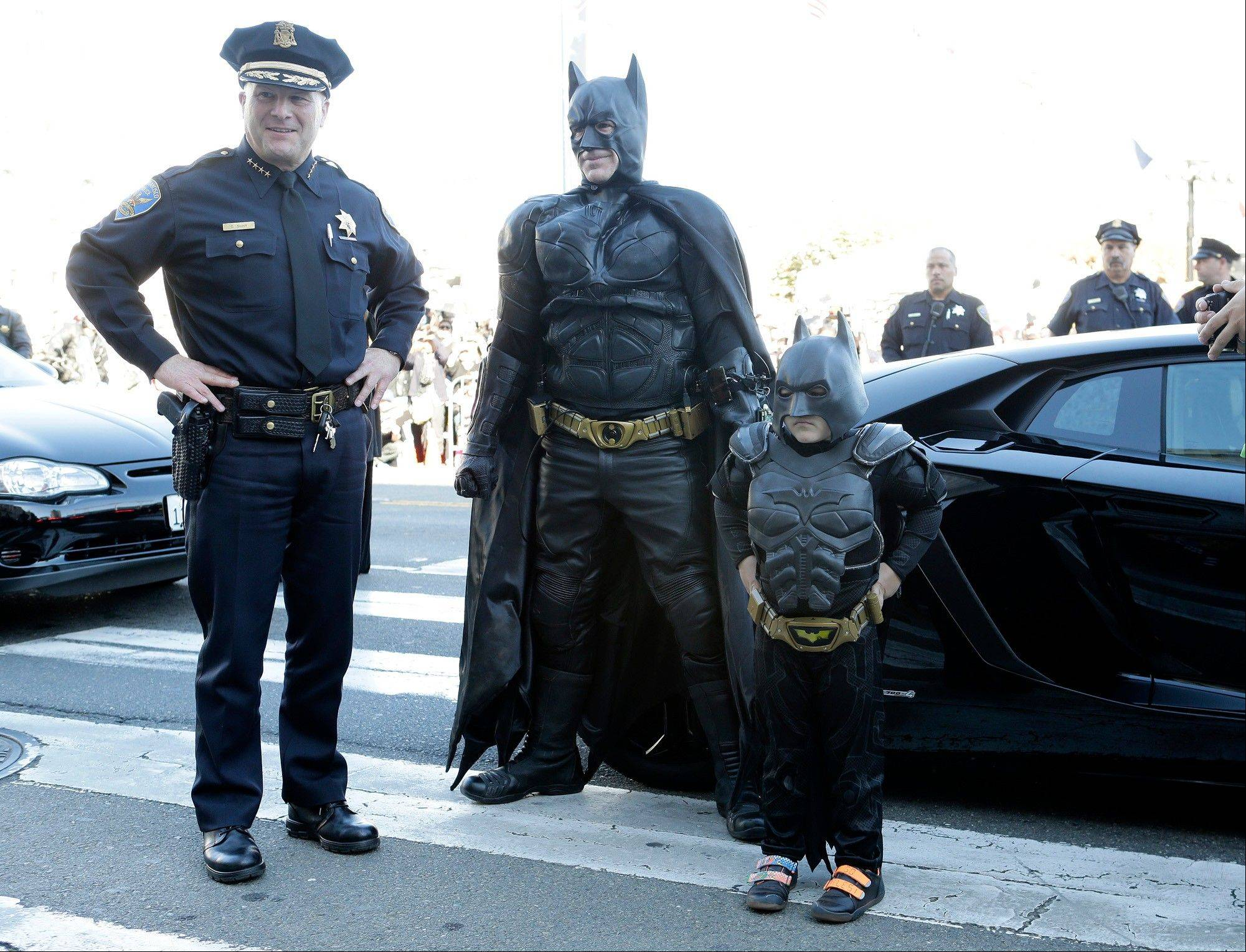 Batkid, Miles Scott, 5, is greeted as he arrives at City Hall in San Francisco Nov. 15, 2013, the day the Make-A-Wish Greater Bay Area granted his wish to be Batkid for a day.