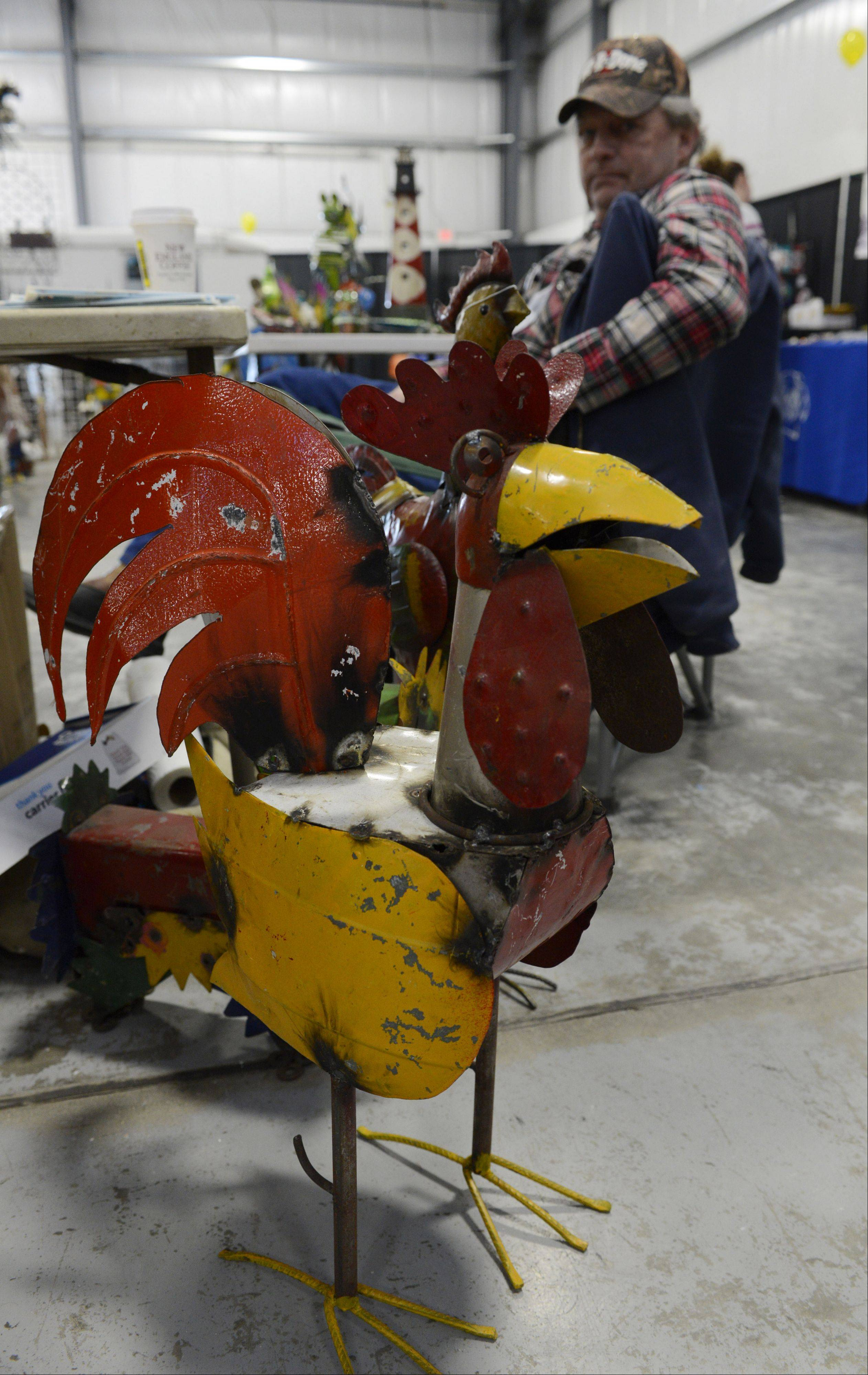 JOE LEWNARD/jlewnard@dailyherald.comA fabricated metal rooster was among the items being sold by Stan Thorson of Stan's Ornamental Iron of Ottawa, Ill., on Sunday at the Home Building and Remodeling Expo at the Lake County Fairgrounds in Grayslake. The event featured demonstrations and presentations at more than 100 booths.