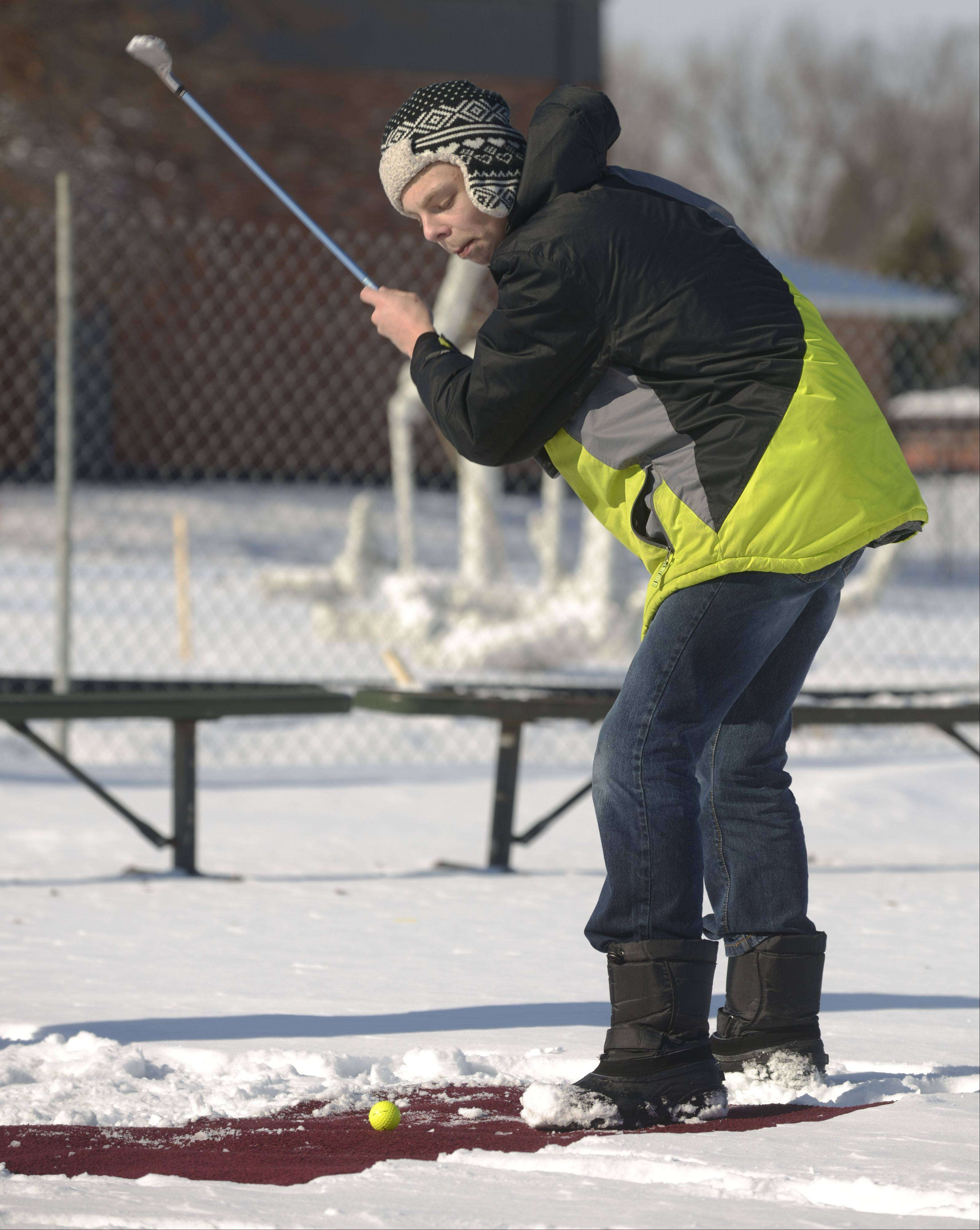 Jason Elbert, 16 of Addison tries out snow golf Sunday at Addison's annual WinterFEST at Community Park. The event featured other winter-themed events like marshmallow roasting, as well as indoor activities like an obstacle course and bounce house.