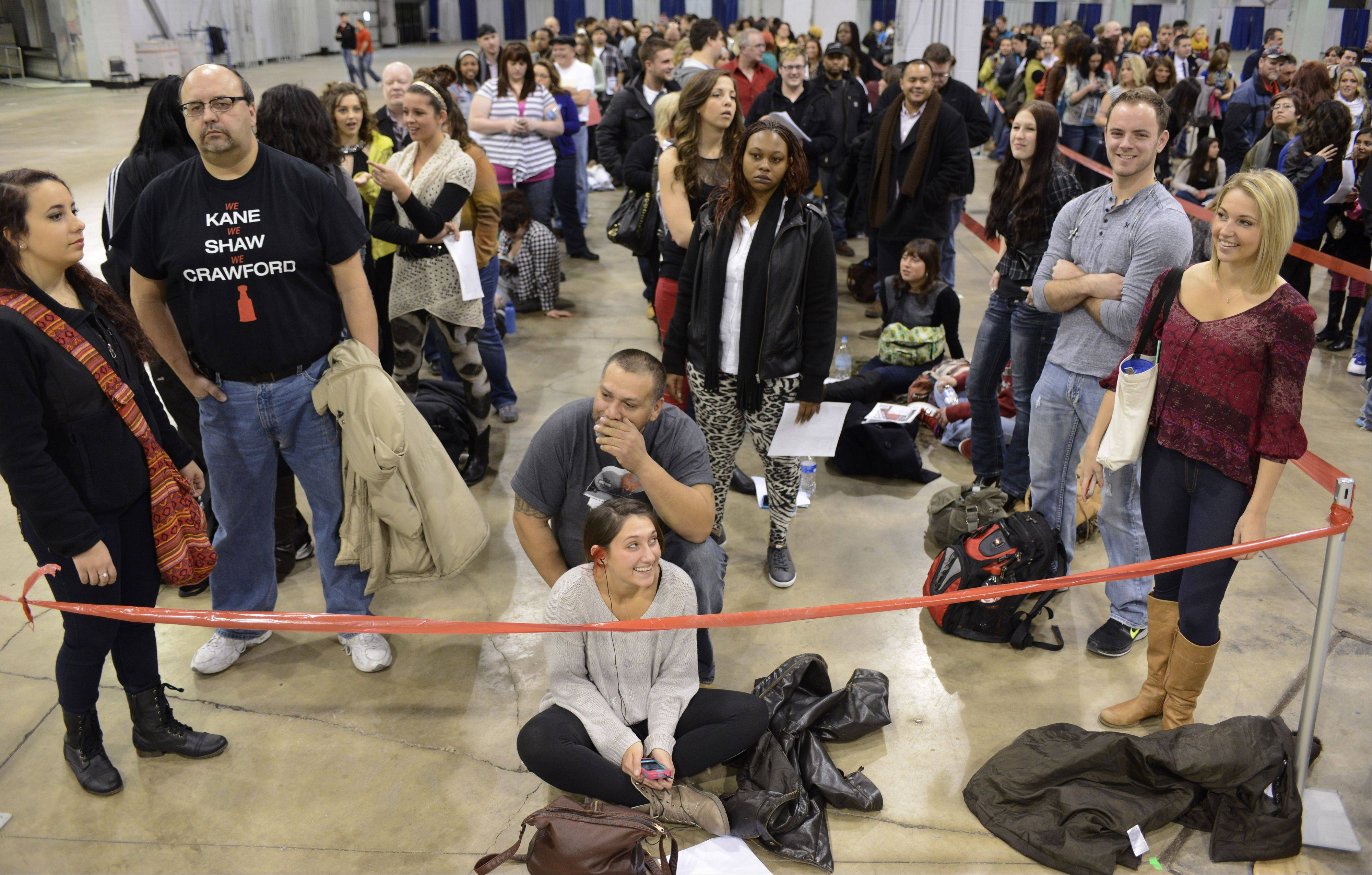 "JOE LEWNARD/jlewnard@dailyherald.comA crowd of hopefuls waits in line Sunday to try out for the NBC television signing competition ""The Voice"" at the Stephens Convention Center in Rosemont."