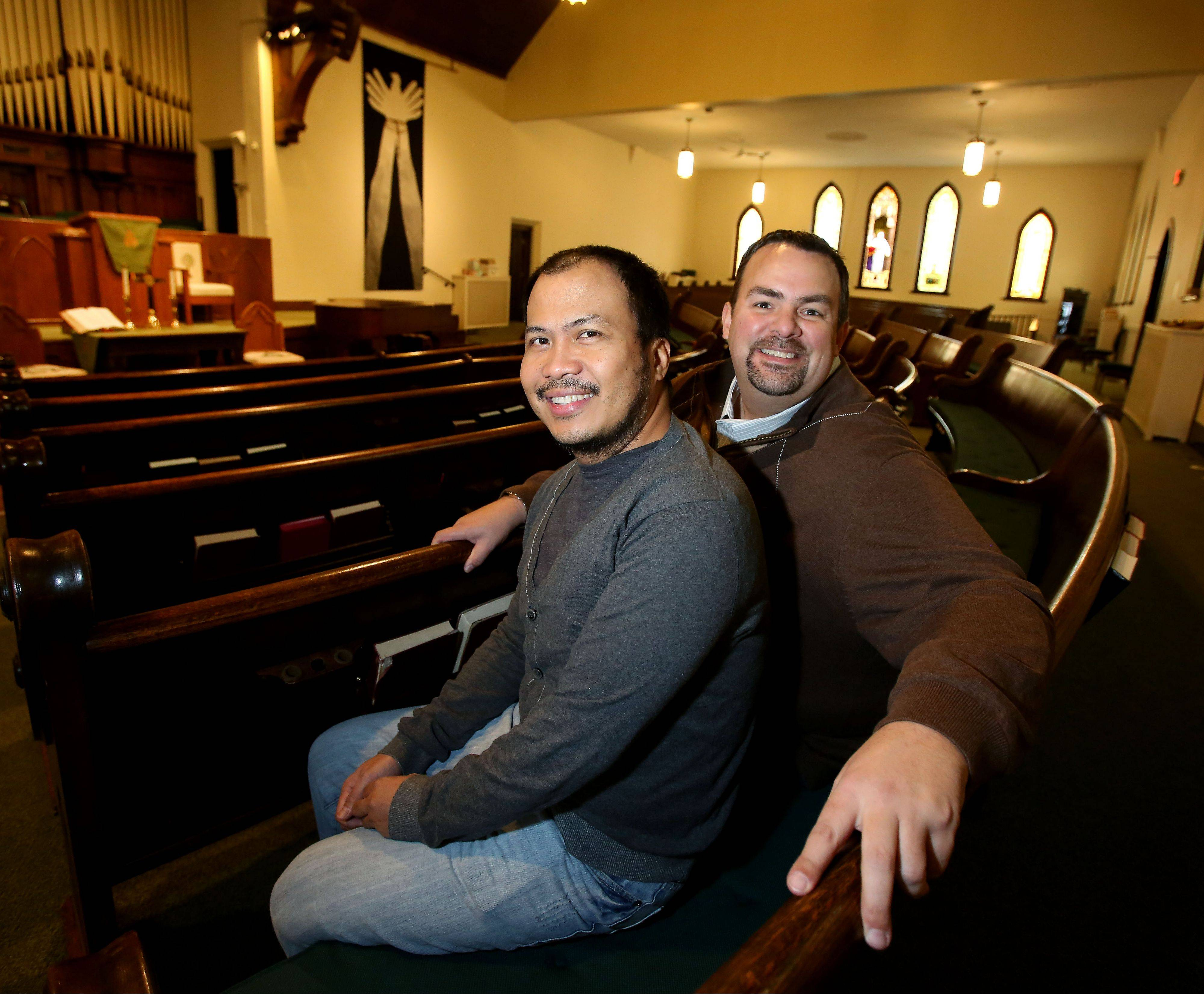 Jovi Tomaneng, left, and John Stilp, right, of Naperville will be getting married in August at First Congregational United Church of Christ in Naperville. The couple say they wanted to have a religious ceremony for their wedding.
