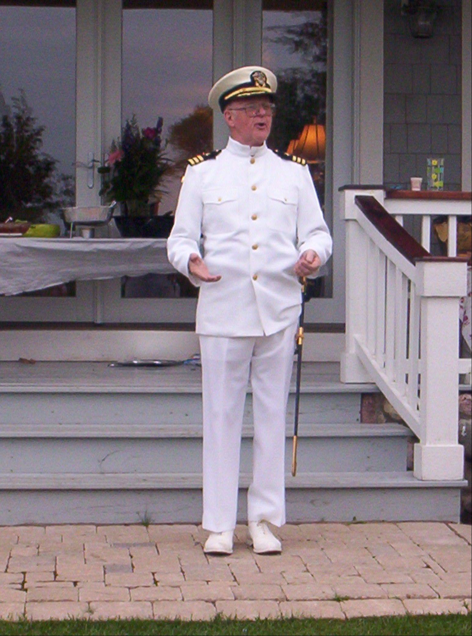 Still able to fit in his formal dress white uniform, retired Navy Cmdr. Robert Griffith of Arlington Heights attends a military reunion in 2006.