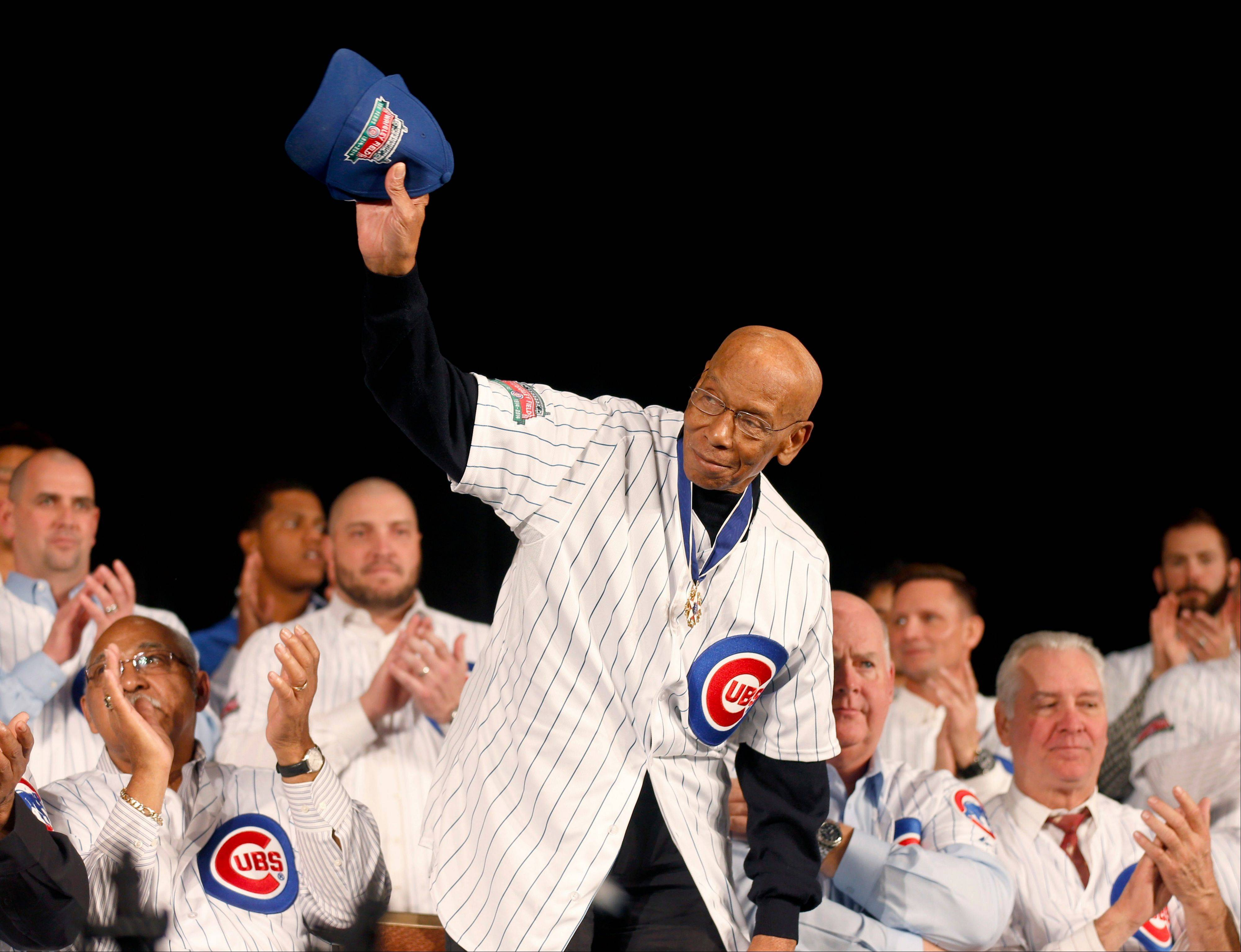 Mr. Cub Ernie Banks waves to the fans during the Cubs convention.