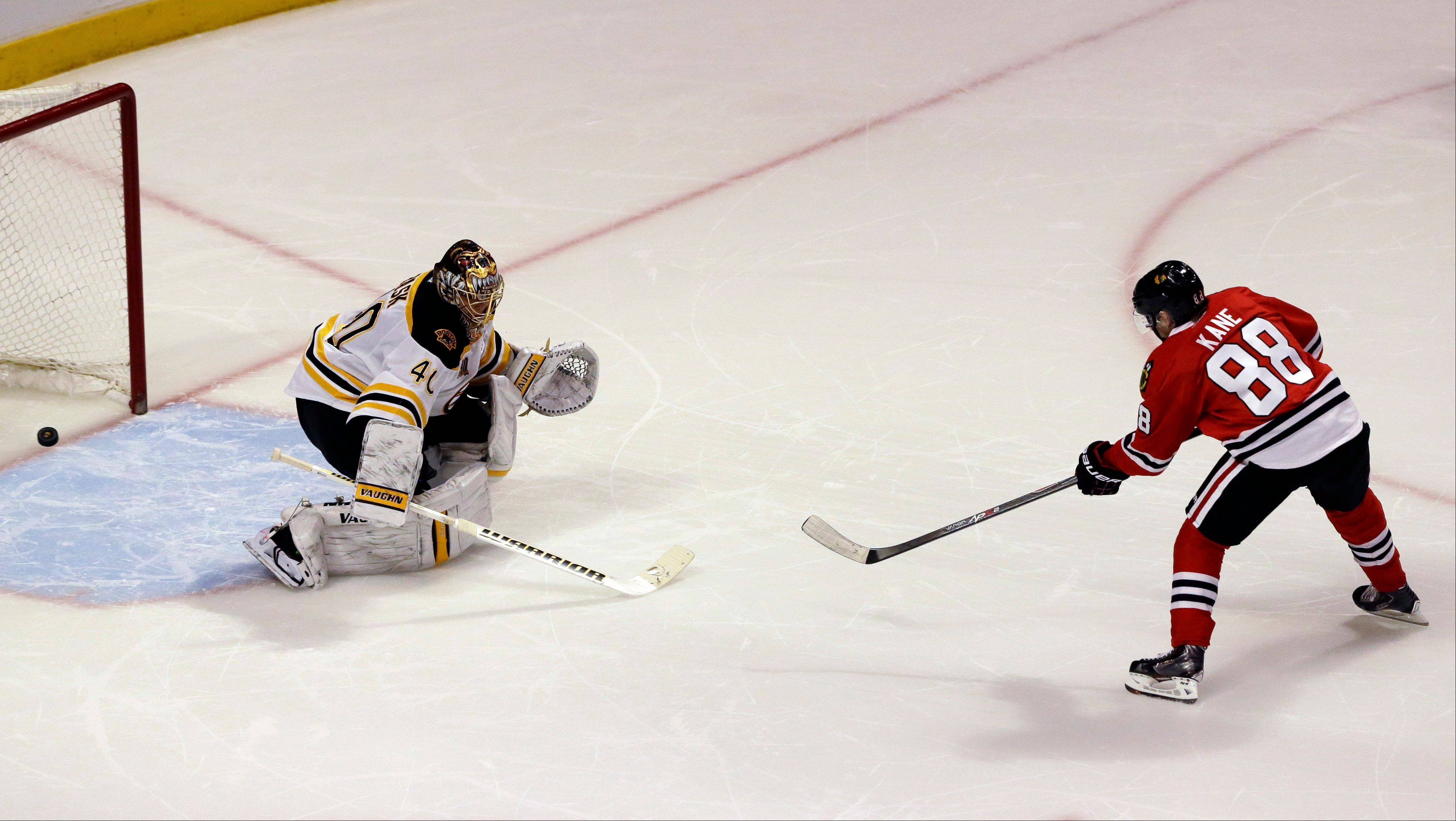 Blackhawks winger Patrick Kane scores against Boston Bruins goalie Tuukka Rask during the shootout of an NHL hockey game in Chicago, Sunday, Jan. 19, 2014. The Blackhawks won 3-2.
