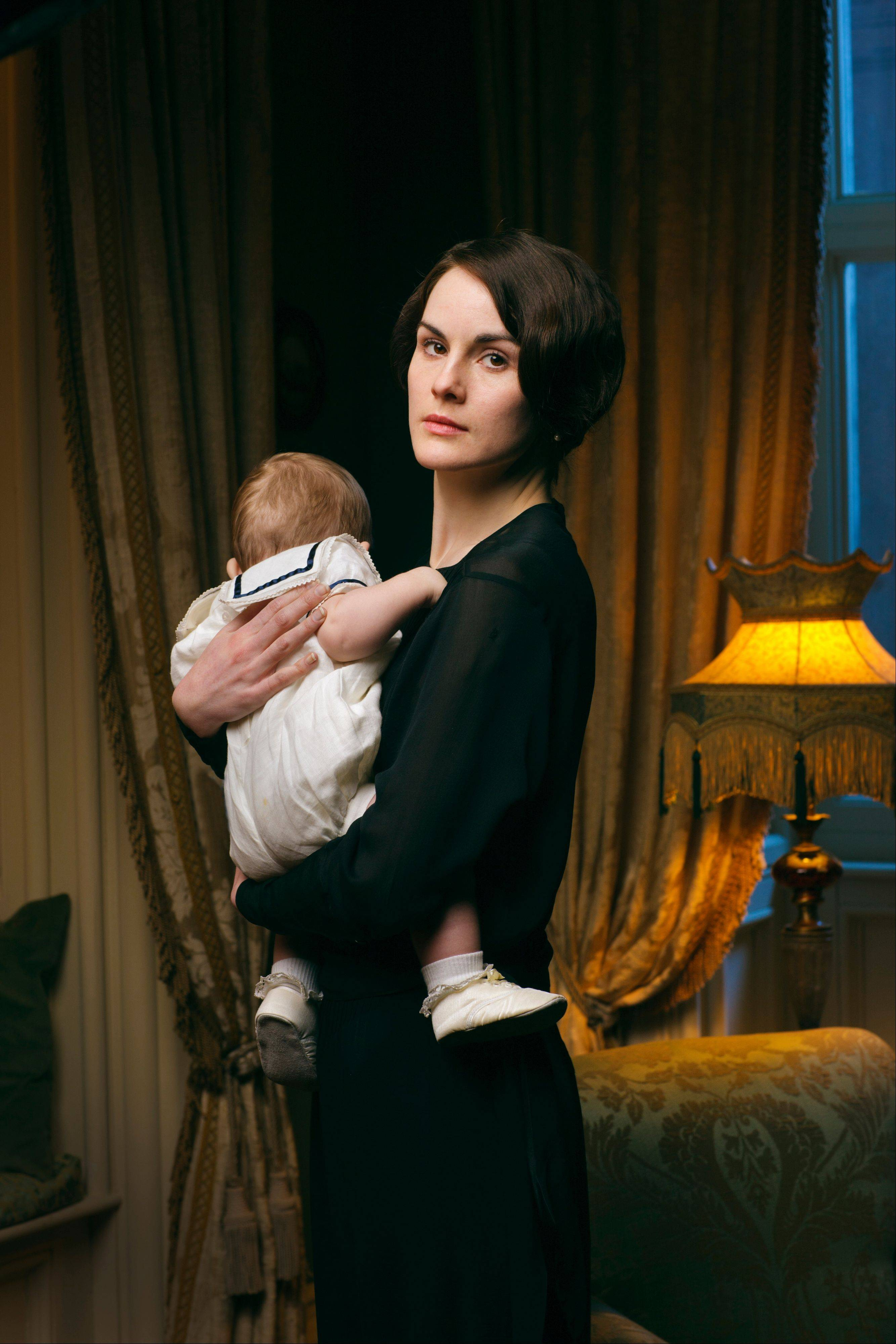 This photo released by PBS and Carnival Film and Television Limited shows Michelle Dockery as Lady Mary in a scene from the Masterpiece TV series, �Downton Abbey.� As it returns Sunday, Jan. 5, 2014, for its much-awaited fourth season, �Downton Abbey� remains a series about elegance, tradition and gentility, and the pressures of preserving them.