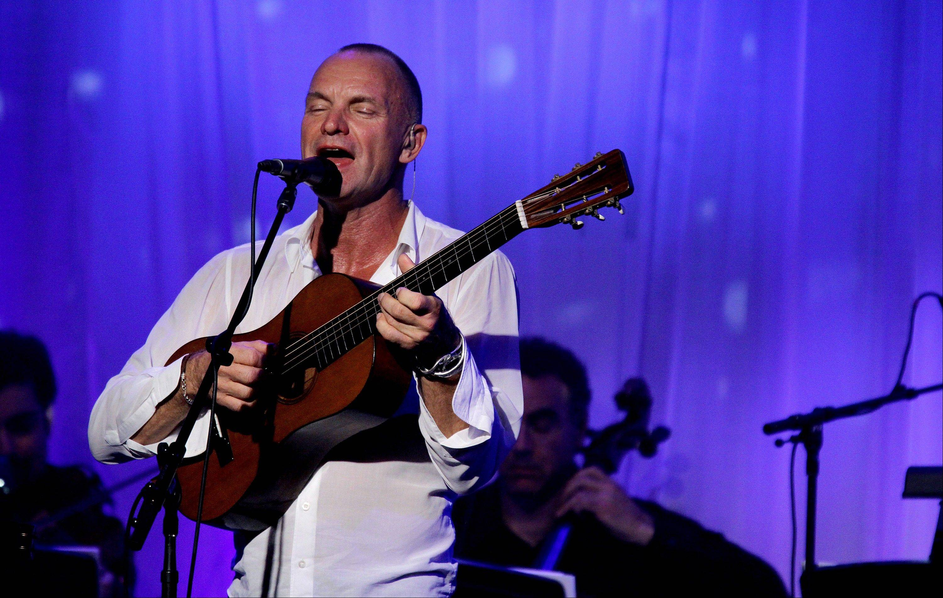 In this Sept. 22, 2011 file photo, 2011 Clinton Global Citizen Award recipient Sting performs at the Clinton Global Initiative awards dinner in New York. Sting is rehearsing for his upcoming tour with singer-songwriter Paul Simon.