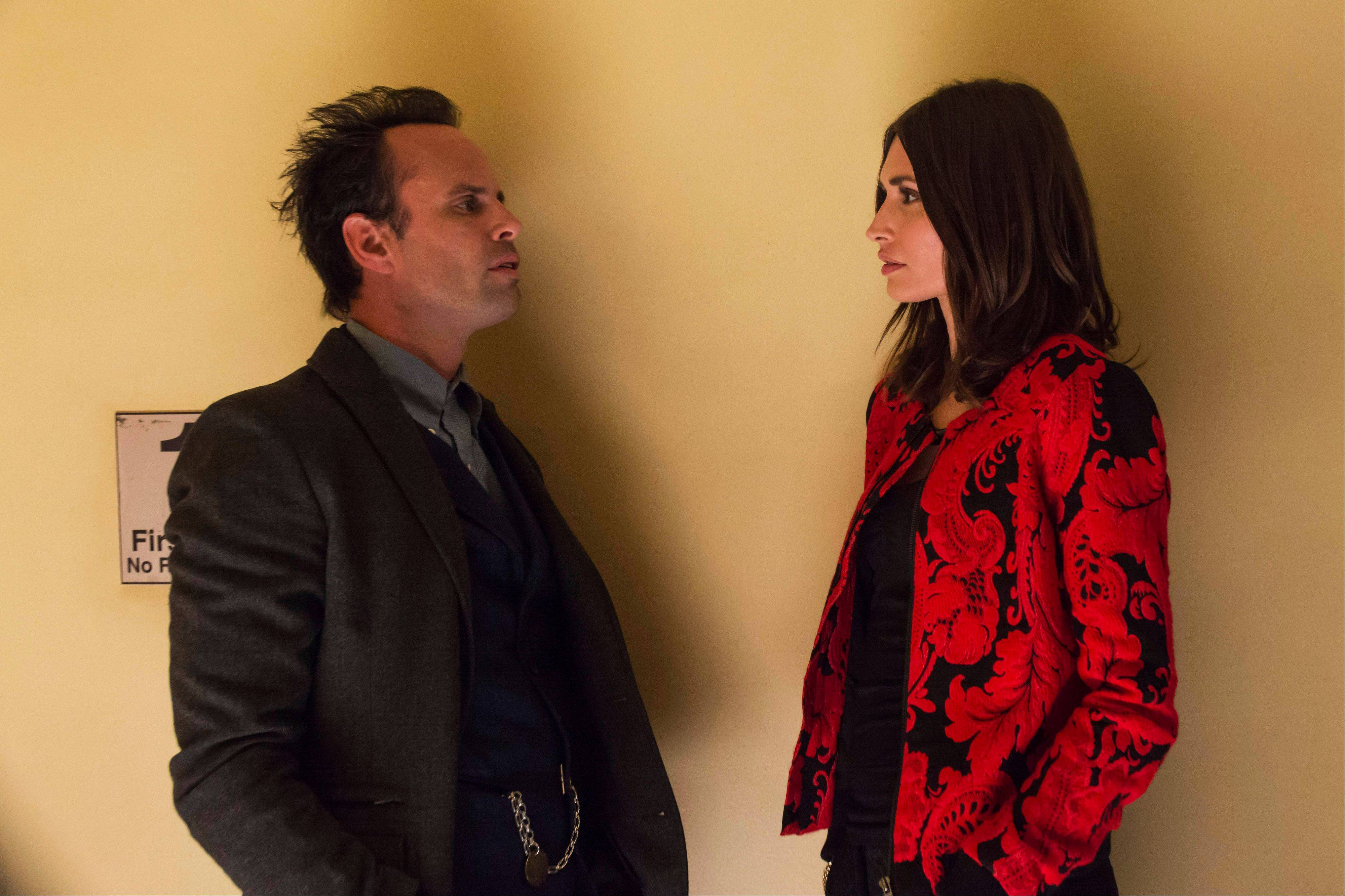 "Walton Goggins, left, as Boyd Crowder, and Karolyna Wydra as Mara, in a scene from ""Justified,"" airing Tuesdays at 9 p.m."