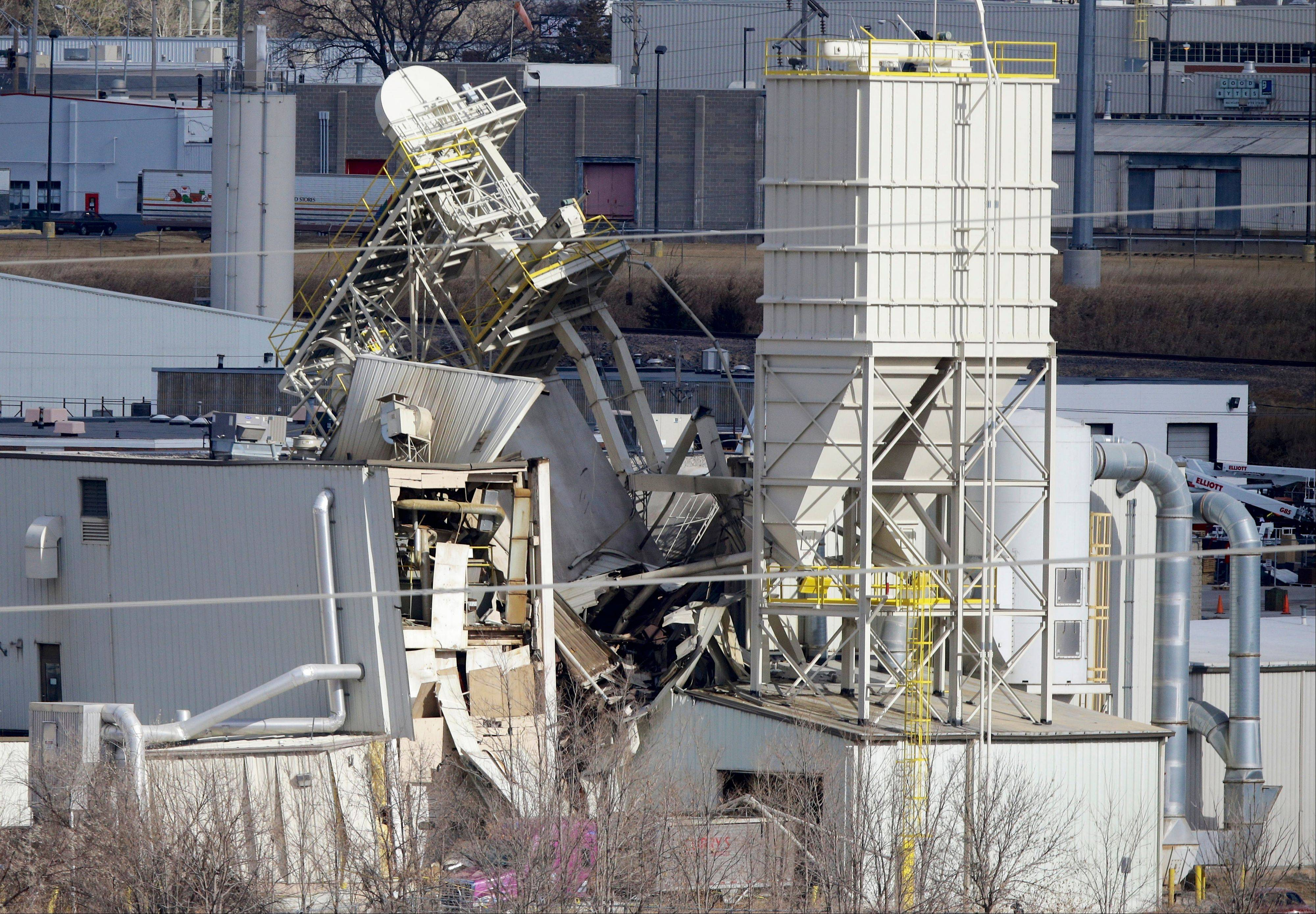 The International Nutrition plant is shown with wreckage in Omaha, Neb., where a fire and explosion took place Monday. Two people were killed and 10 others were seriously injured.