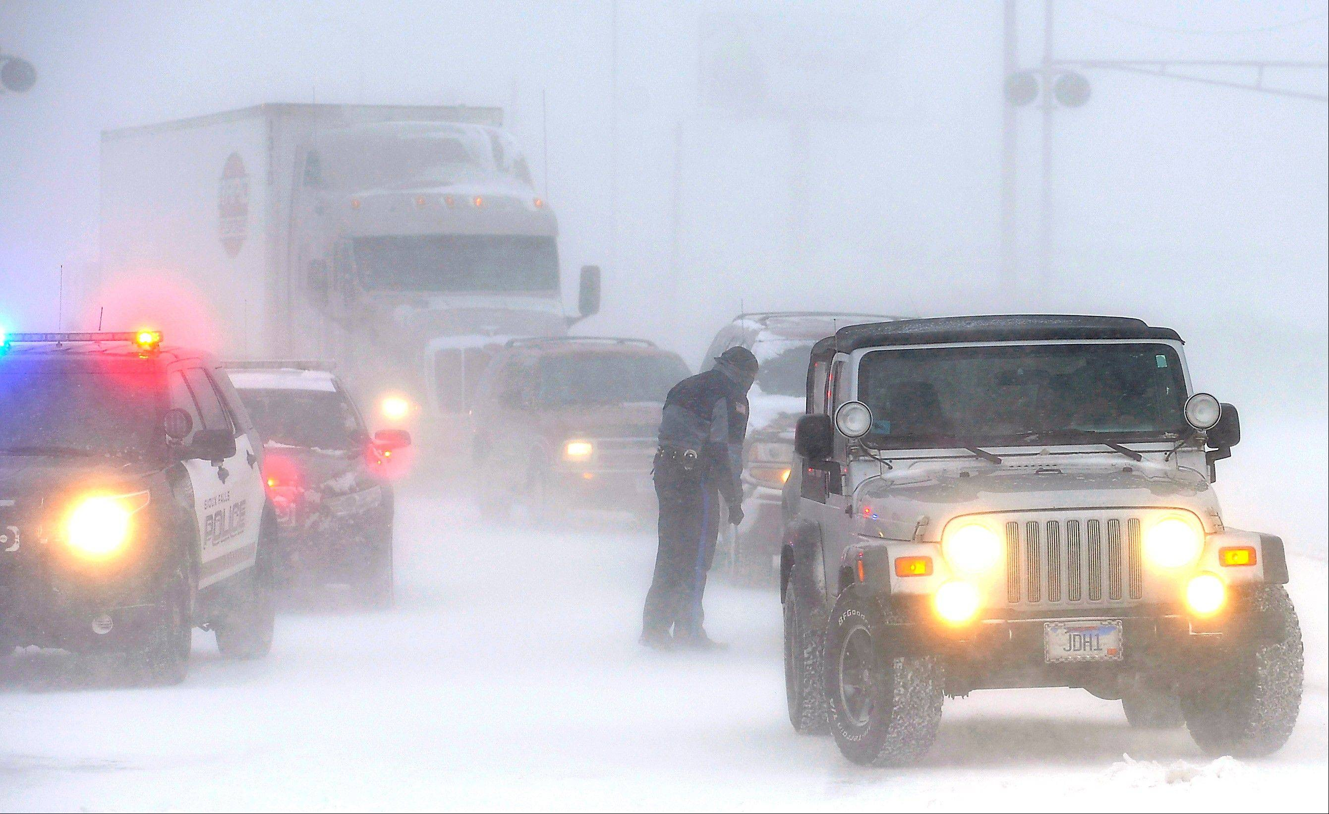 Officer Chris Bauman redirects traffic due to closed roads in Sioux Falls, S.D., Thursday. Temperatures plunged below zero in North Dakota and northern Minnesota on Monday morning. The cold front was expected to sweep south into Iowa and and Illinois.