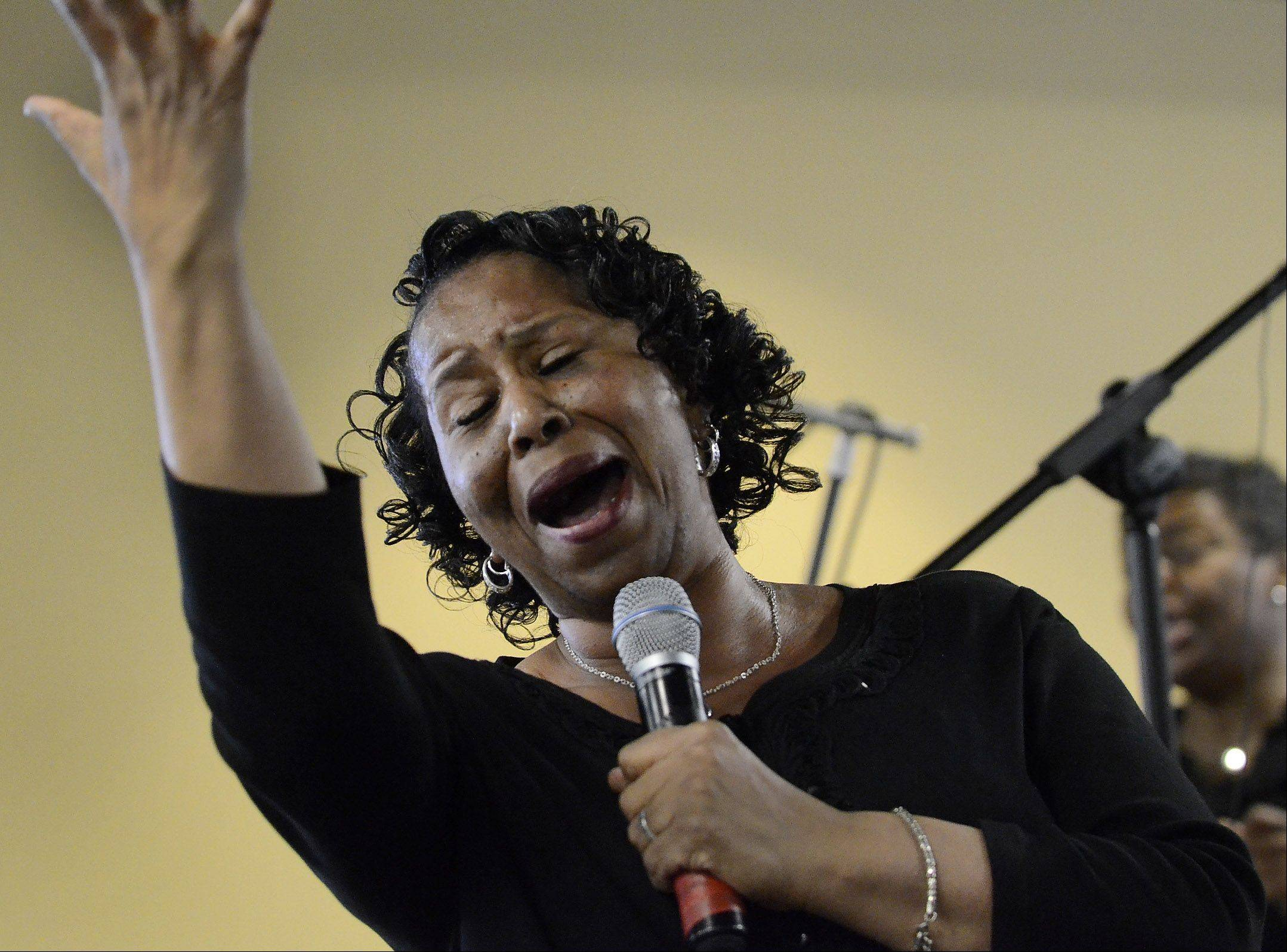 Vanessa Meeks, of the Sears Holdings Associate Gospel Choir, sings a solo during the Hoffman Estates Cultural Awareness Commission�s 12th annual Martin Luther King Jr. Community Breakfast.