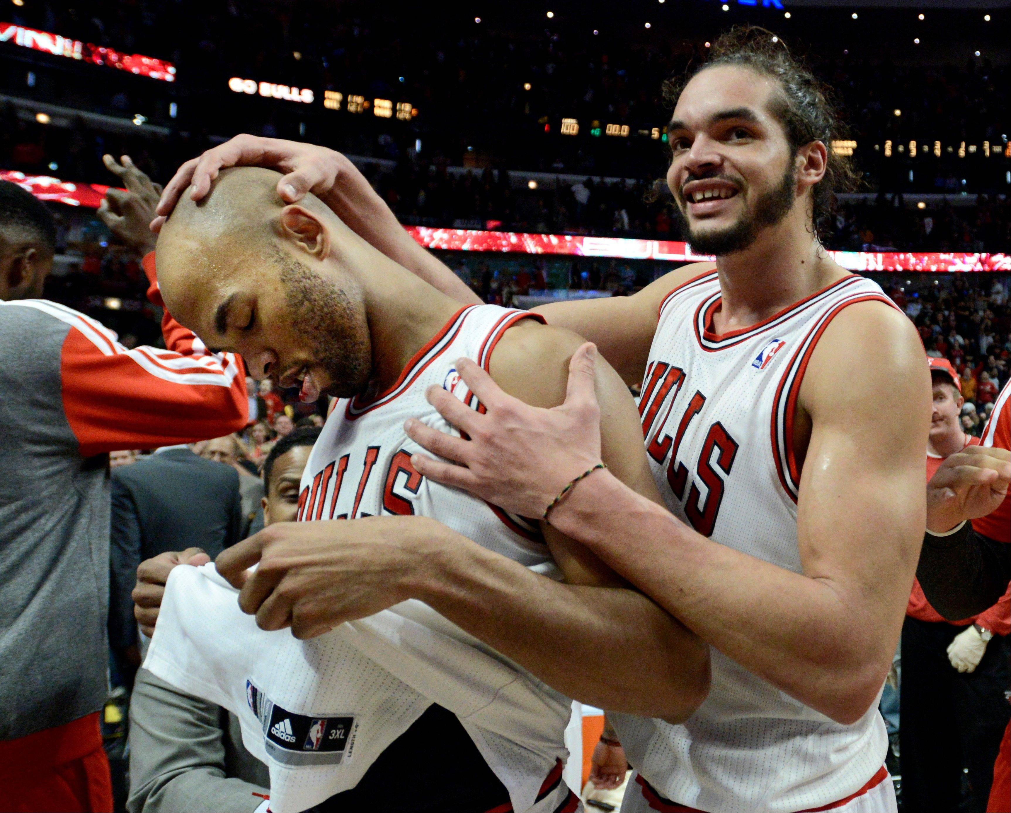 Joakim Noah, right, celebrates with teammate Taj Gibson after Gibson made the game-winning shot in overtime to defeat the Lakers on Monday night at the United Center.