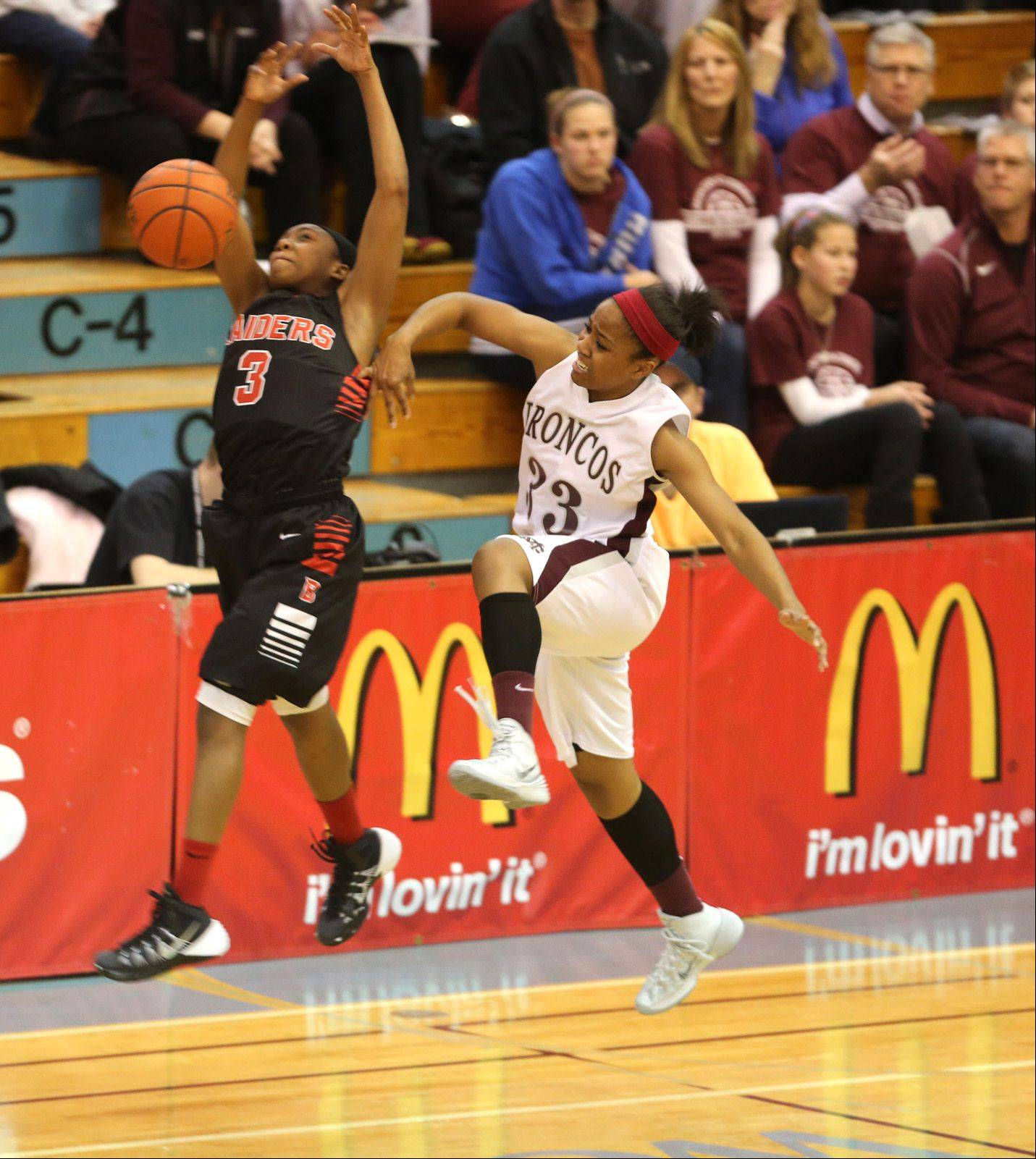 Daniel White/dwhite@dailyherald.com Montini's battles Bolingbrook's during the 24th annual McDonald's Shootout, a girls basketball tournament at Willowbrook High School.