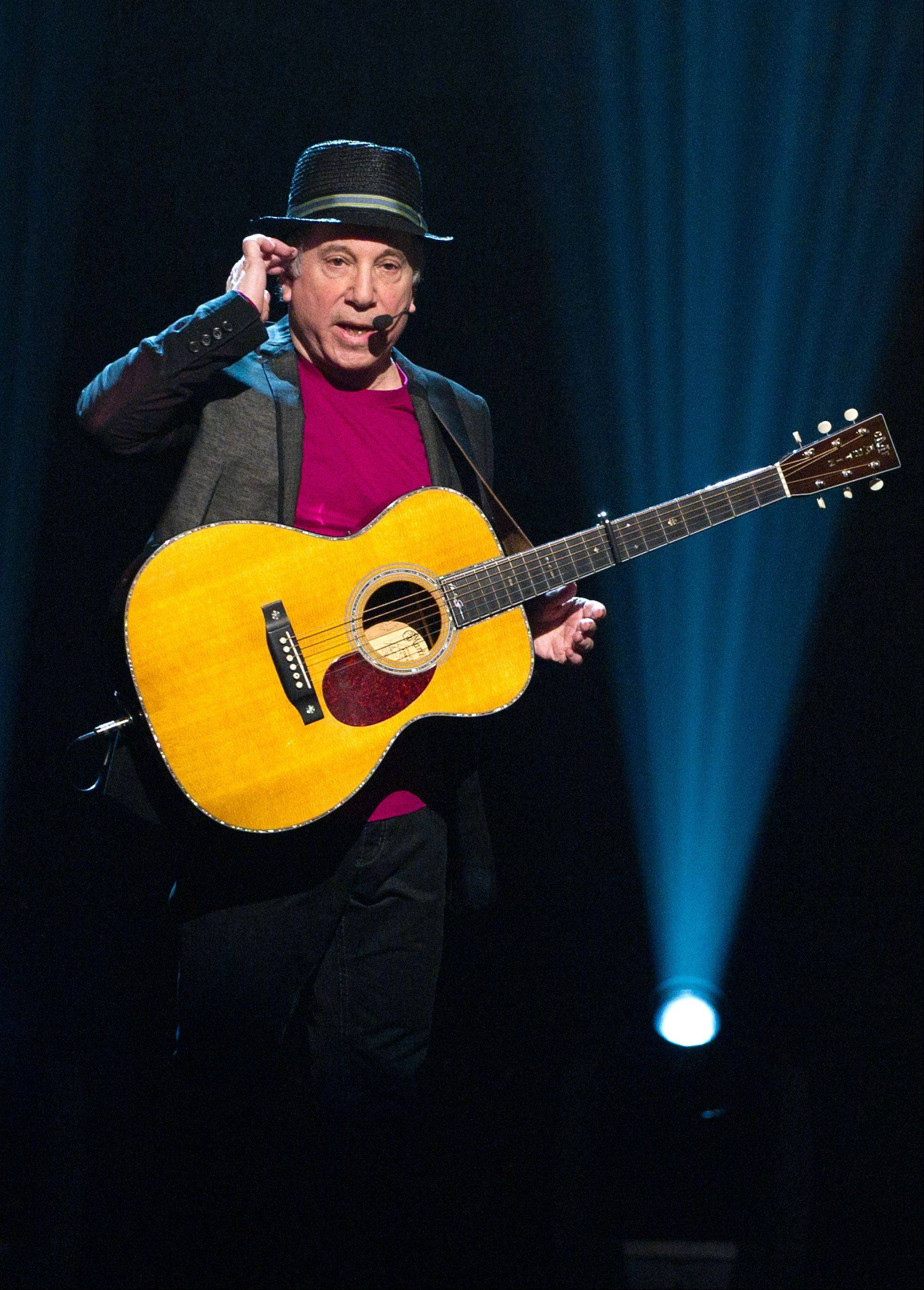 "In this Oct. 2, 2010 file photo, singer Paul Simon appears on stage at Comedy Central's ""Night Of Too Many Stars: An Overbooked Concert For Autism Education"" at the Beacon Theatre in New York. Simon is set to launch a concert tour with Sting."