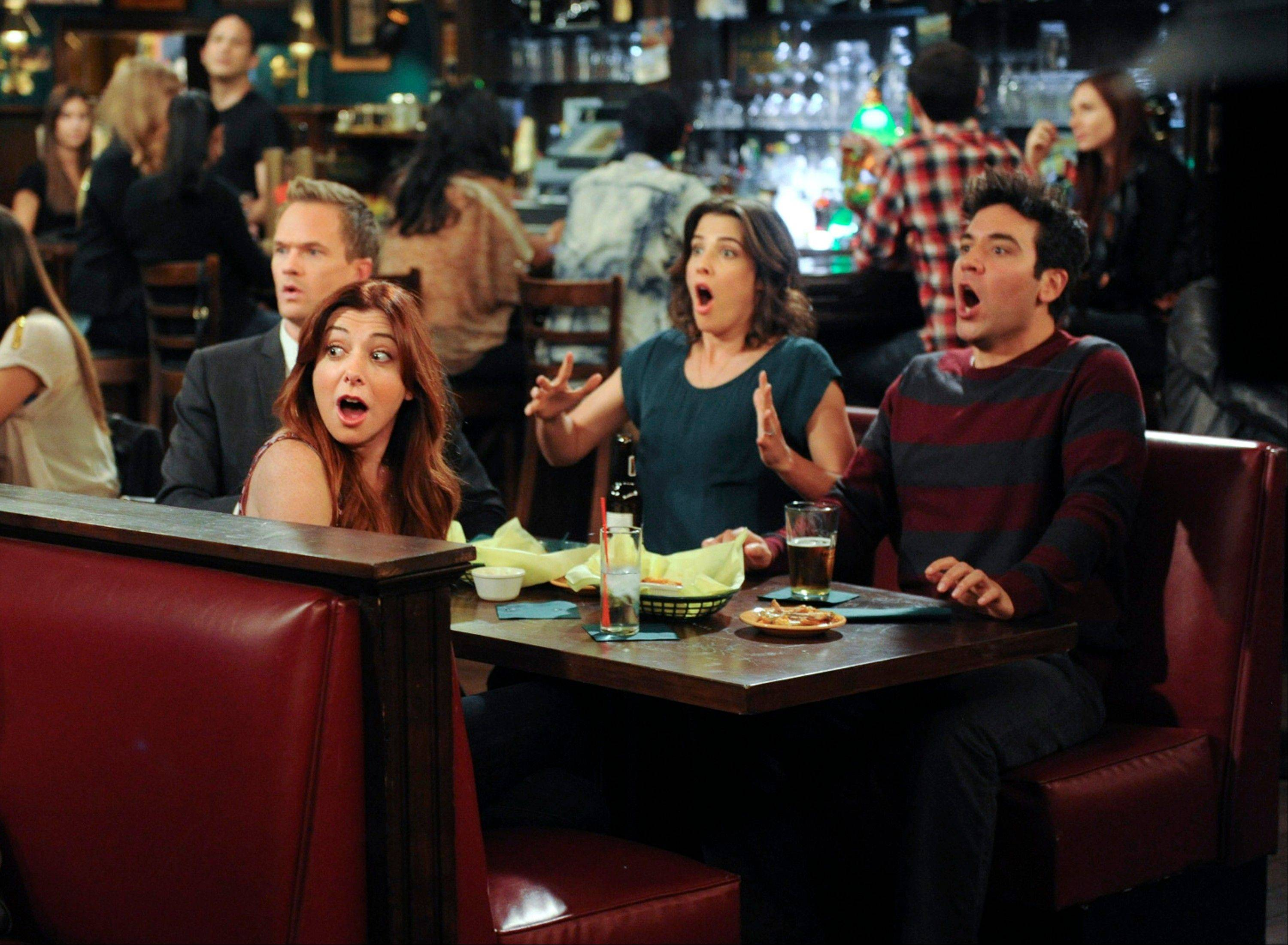 "This image released by CBS shows, clockwise from foreground left, Alyson Hannigan, Neal Patrick Harris, Cobie Smulders and Josh Radnor in a scene from ""How I Met Your Mother."" Producers filmed the climactic scene of CBS' ""How I Met Your Mother"" finale eight years ago for fears that the actors involved would become unrecognizable, and have kept it under wraps ever since. The Monday night comedy concludes after nine seasons on March 31 with a one-hour episode."