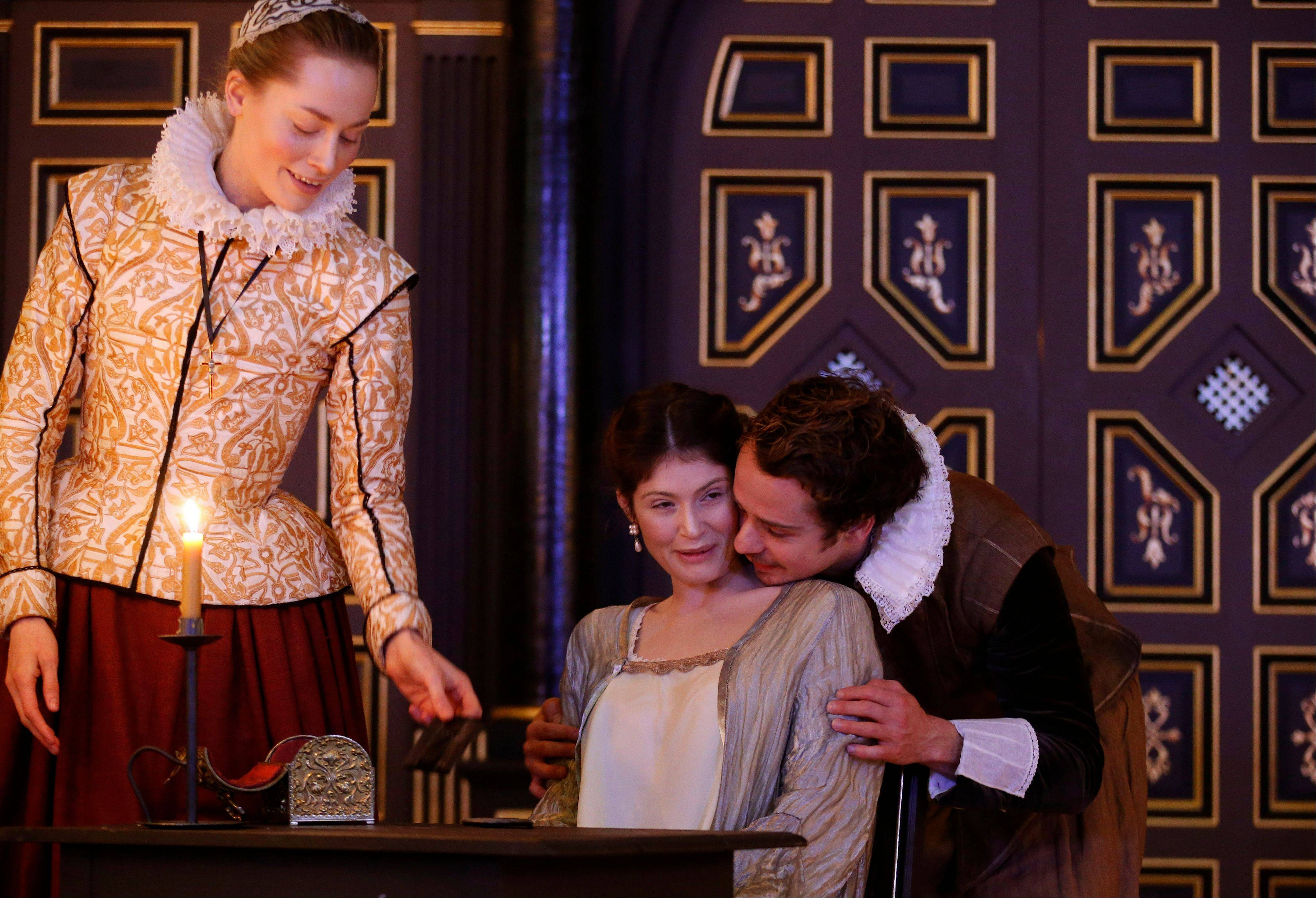 "Gemma Arterton as The Duchess of Malfi, center, Alex Waldmann as Antonio and Sarah MacRae as Cariola star the play ""The Duchess of Malfi"" at Shakespeare's Globe's new indoor theatre called the Sam Wanamaker Playhouse in London."