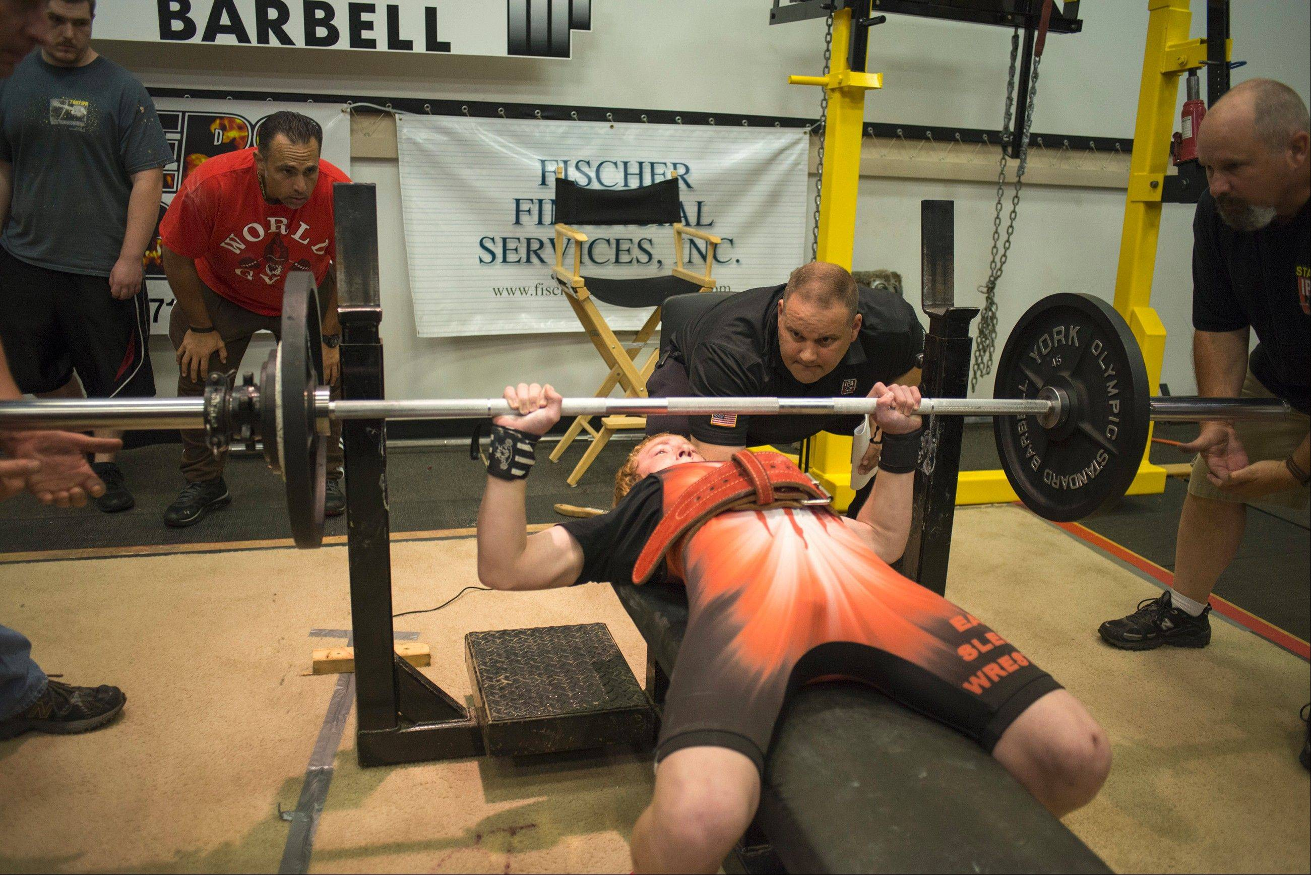 Jake Schellenschlager, 13 at the time, sets a bench-press record for his age and weight at the 2013 IPA Strength Spectacular Powerlifting Bench Press Championships on June 22, 2013, in York, Pa. During the event, he also set records in squat and dead lift.